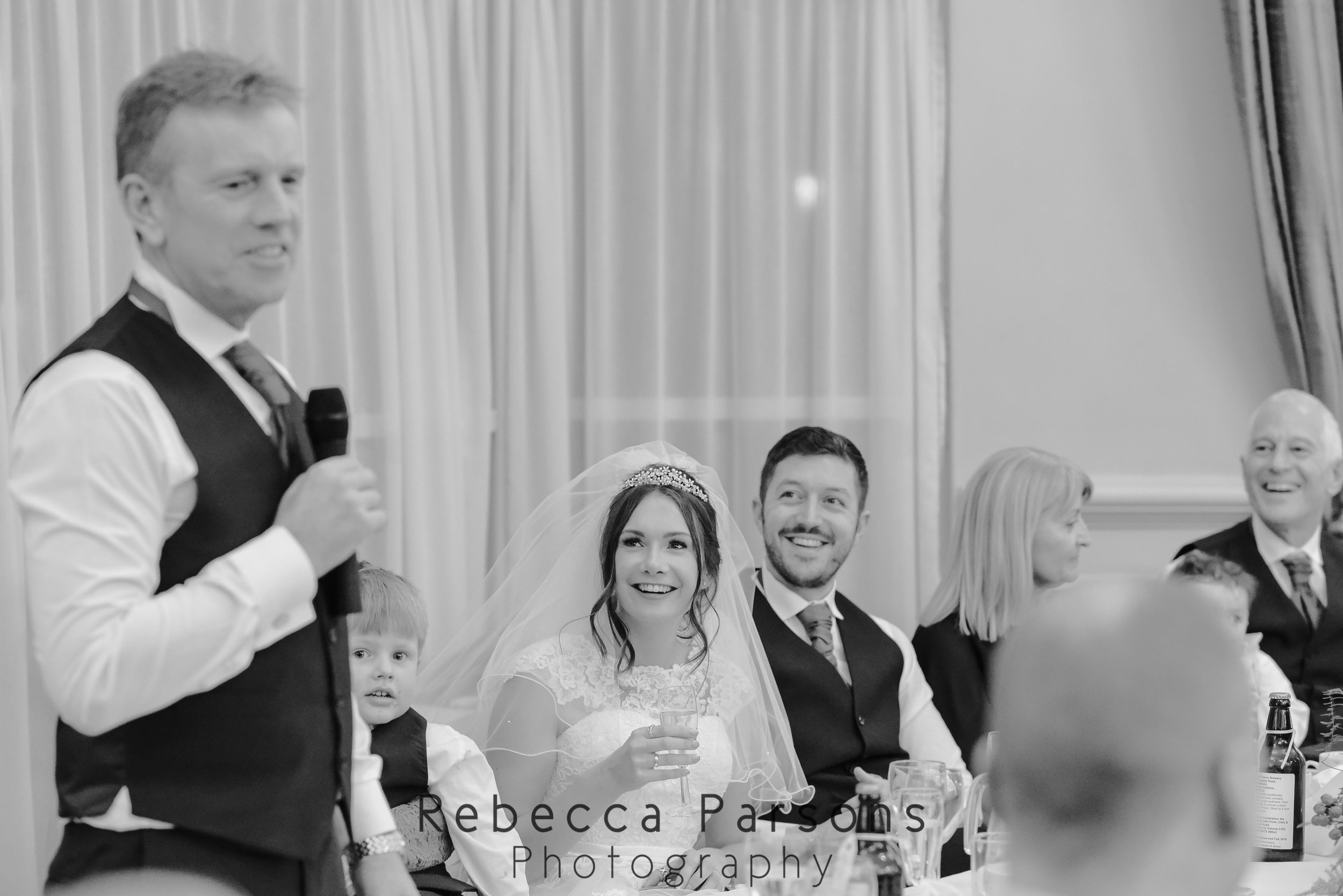 father of bride giving speech black and white