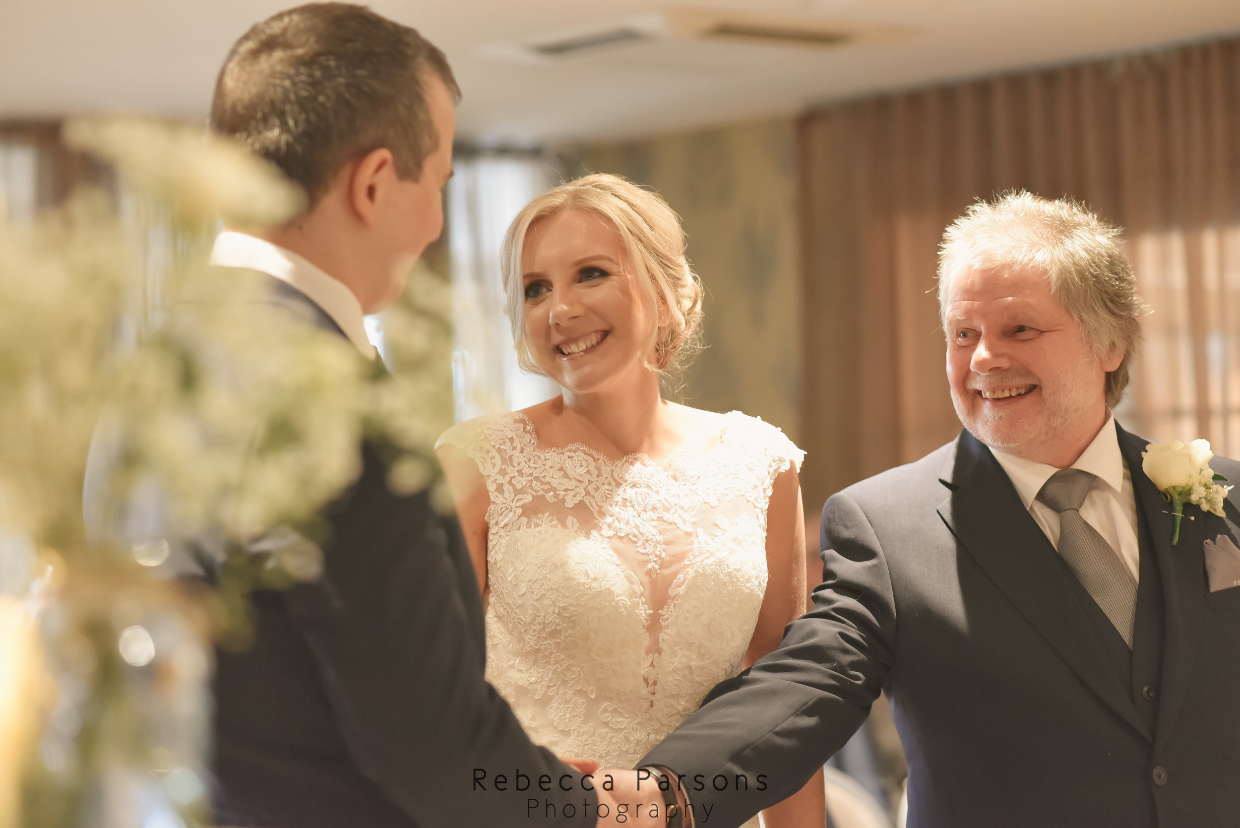 father of bride with bride and groom