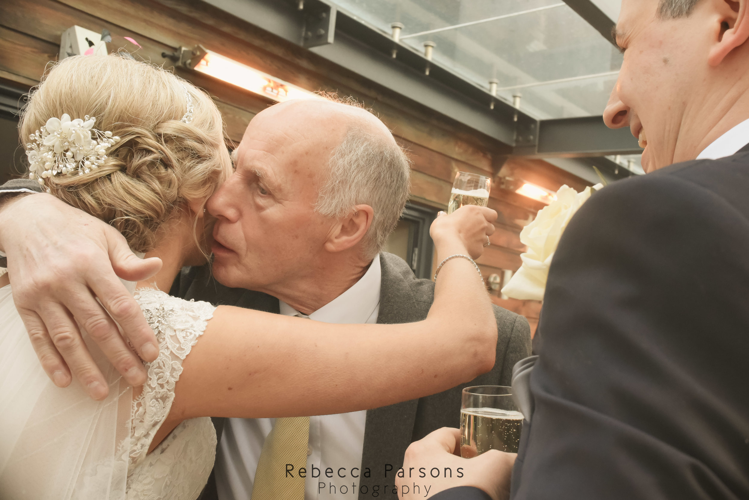 bride kissing guest
