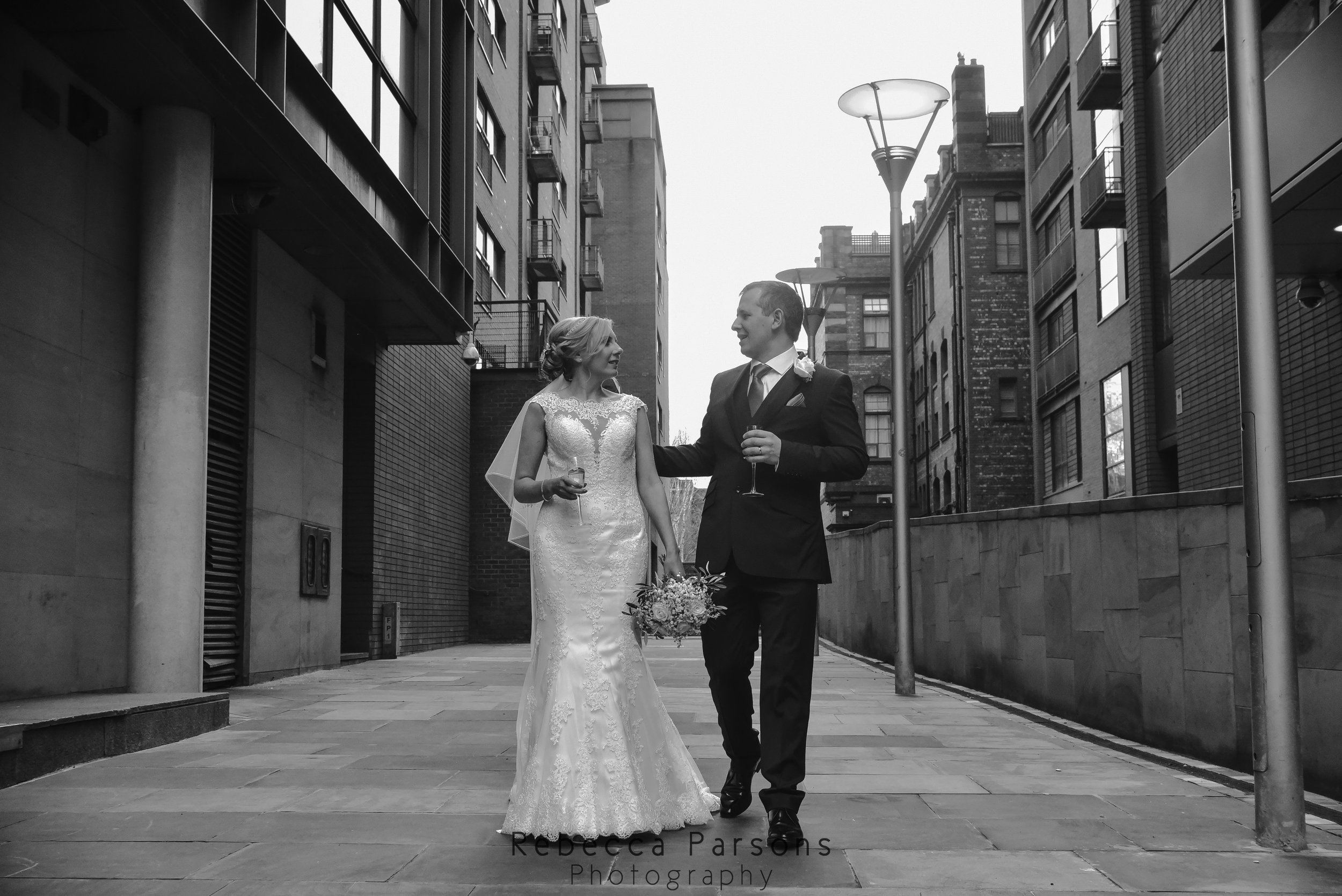 black and white bride and groom walking in Manchester