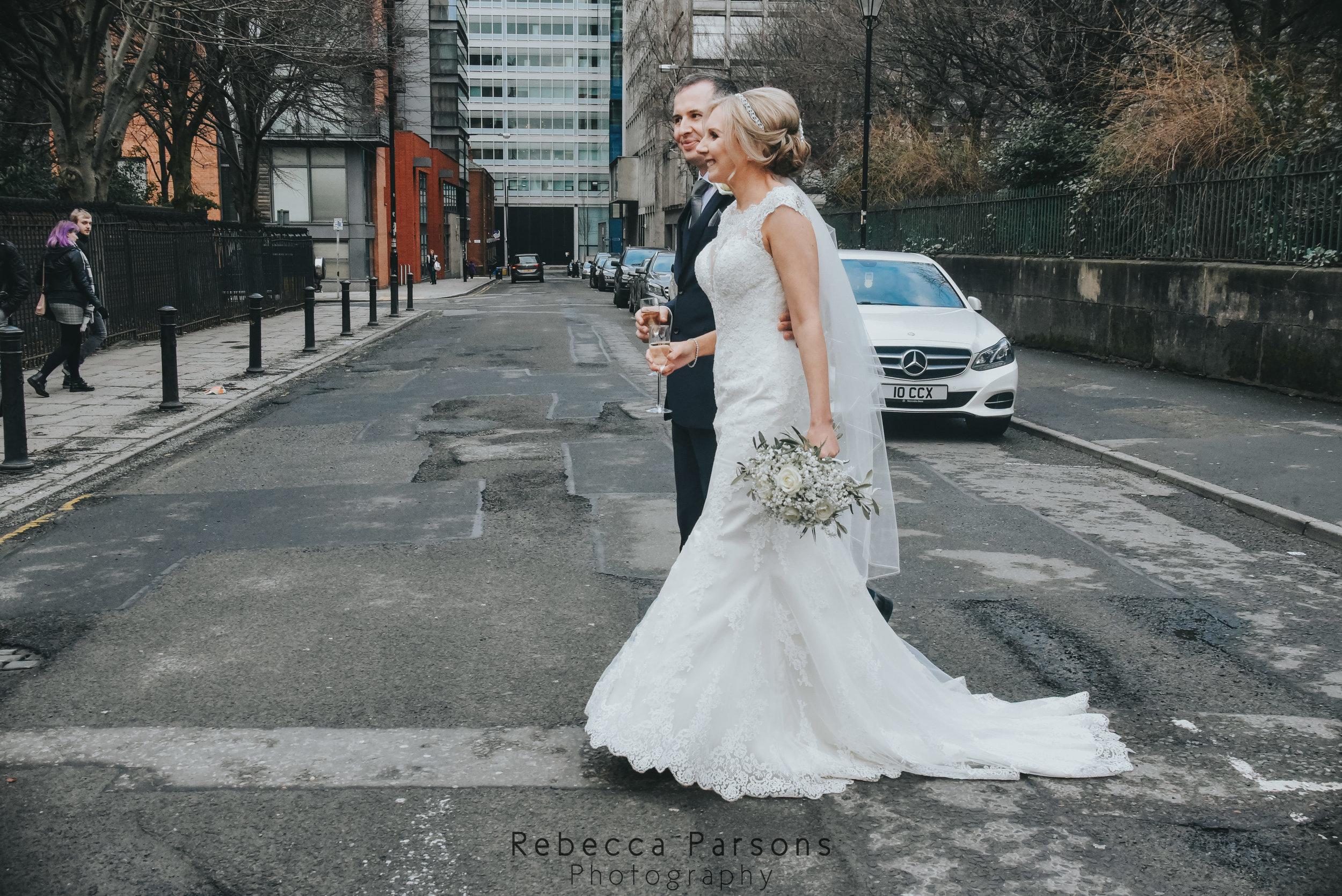 bride and groom crossing road