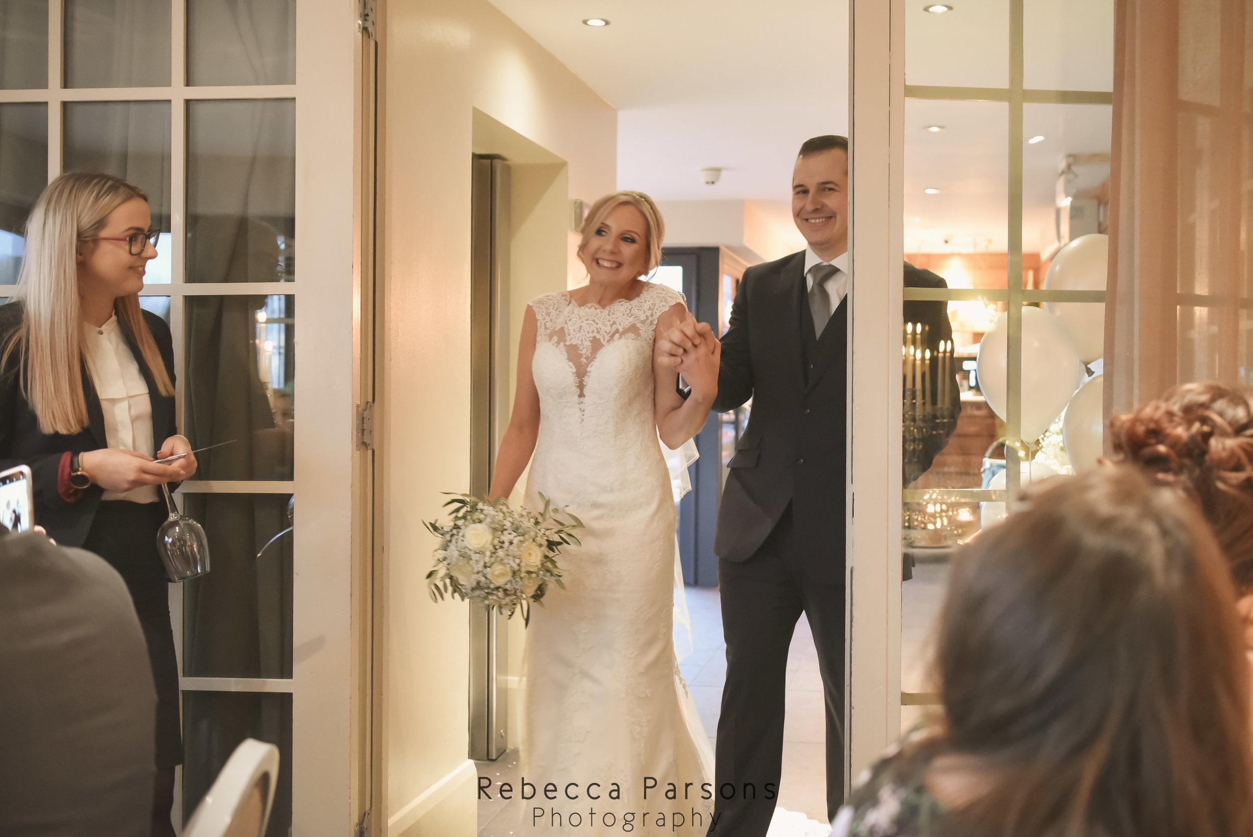 bride and groom walking into breakfast
