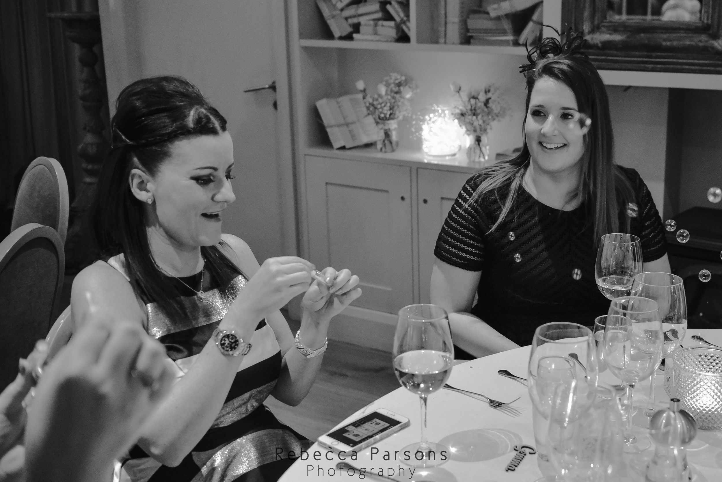 guests blowing bubbles black and white