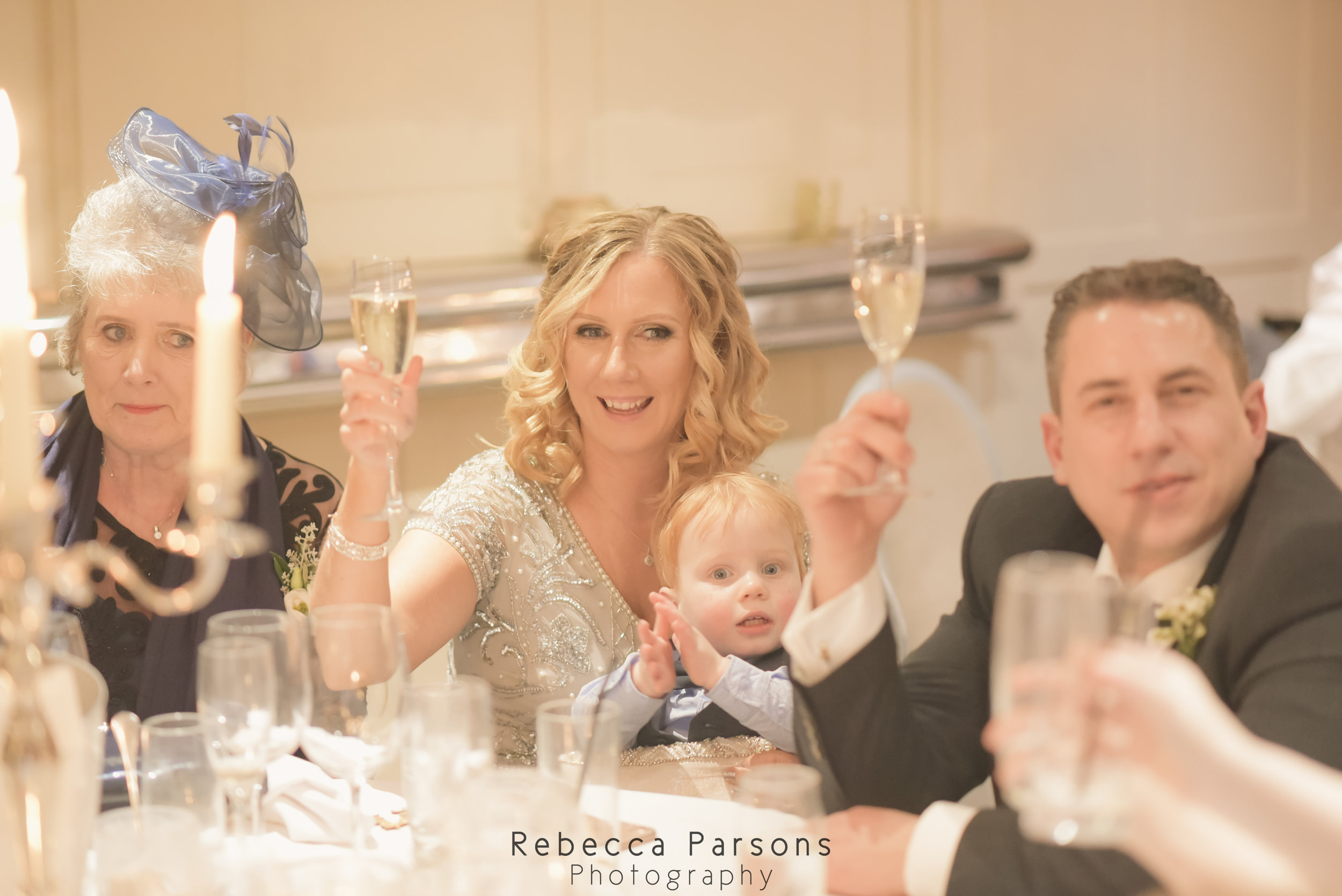 guests raising glasses in a a toast