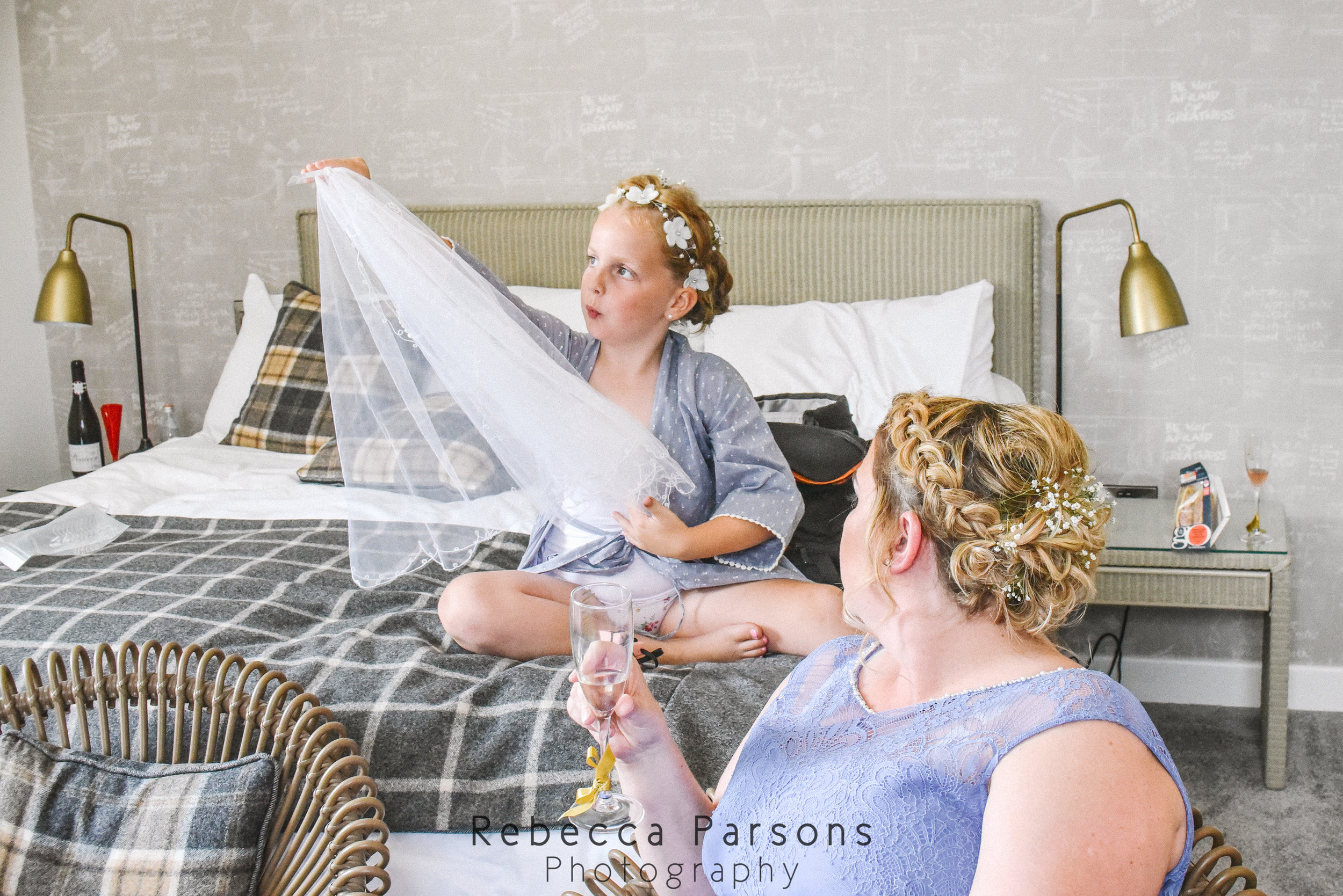 flower girl and bridesmaid with veil
