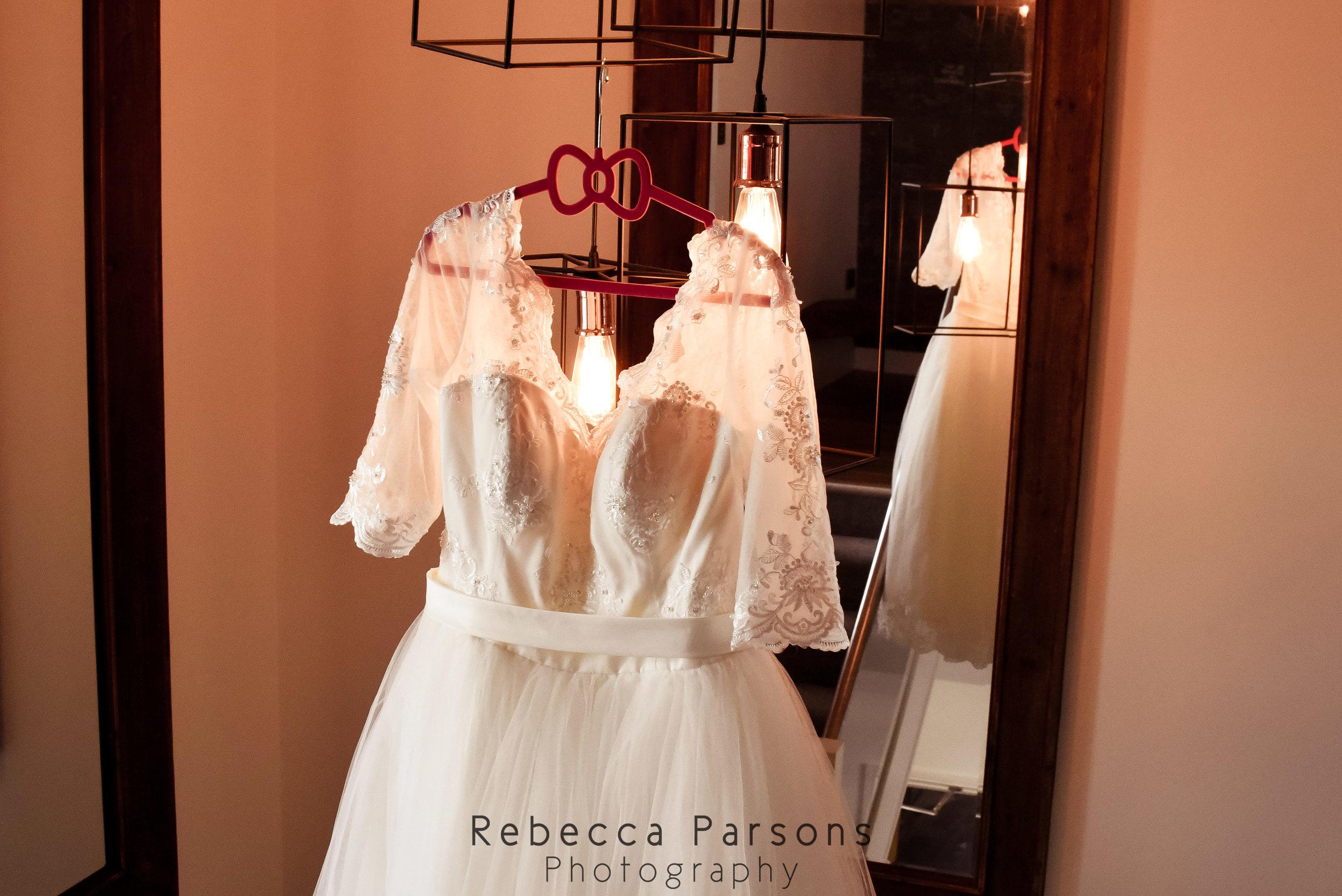 wedding dress hanging from lights