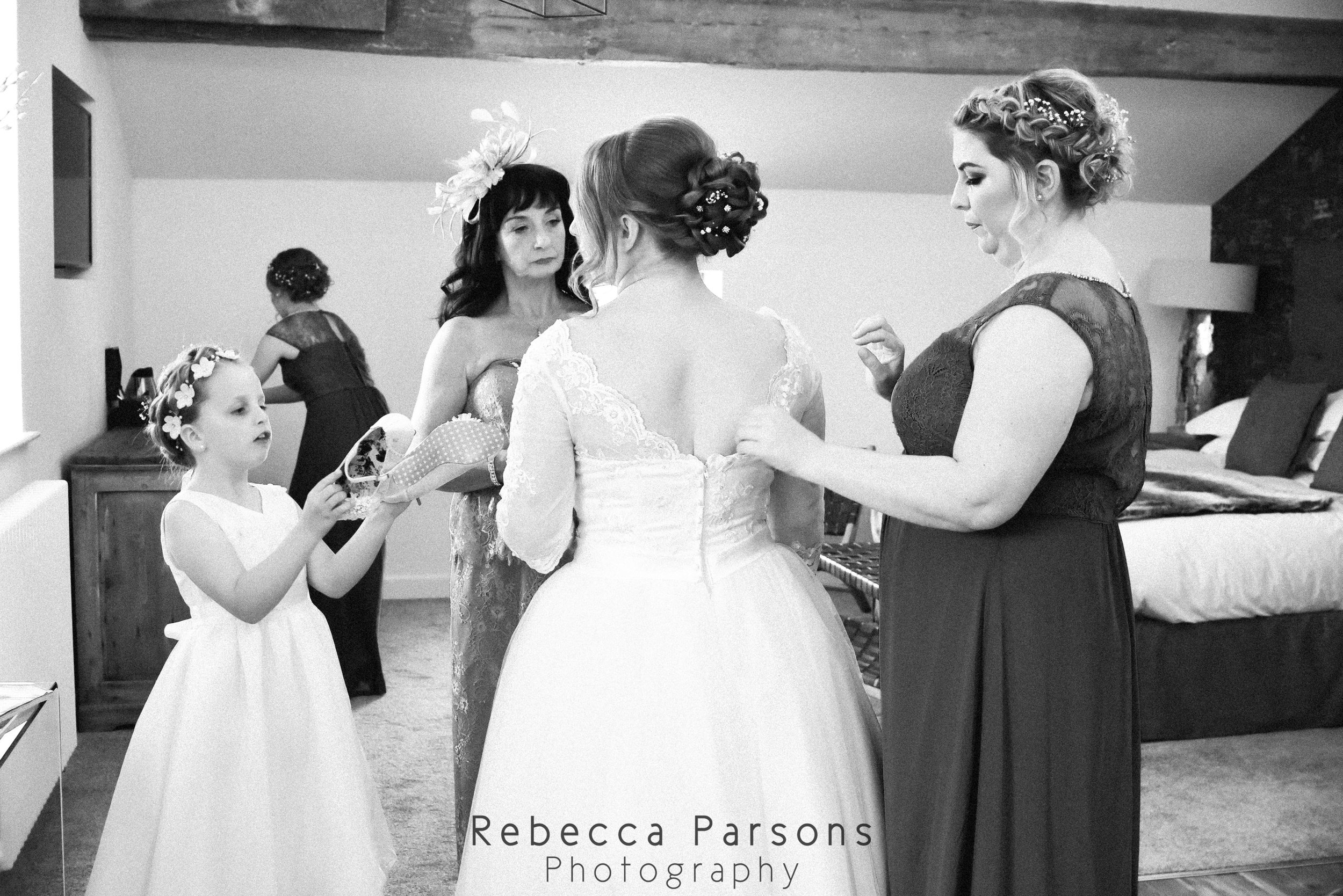 bride dress being adjusted black and white
