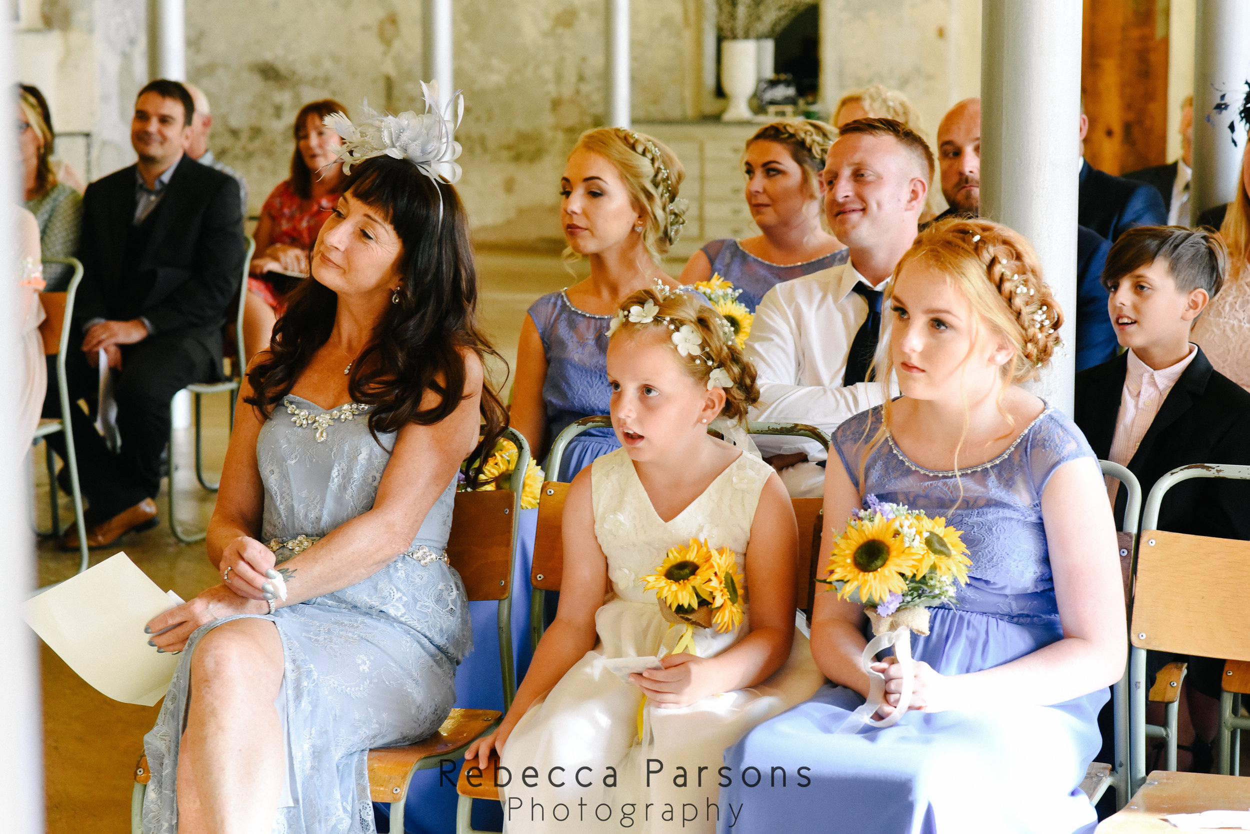 wedding guests watching service