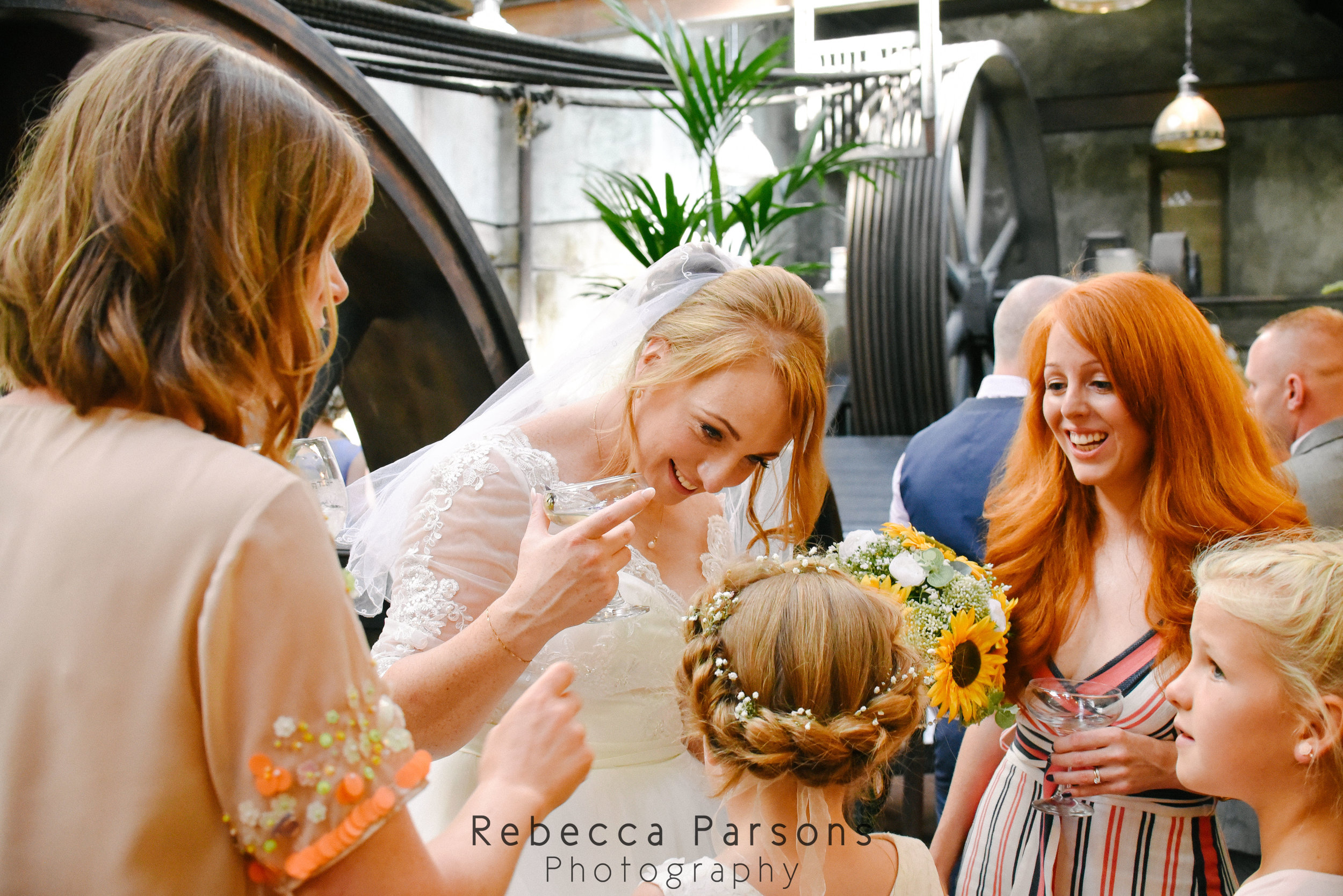 bride and flower girl with guests