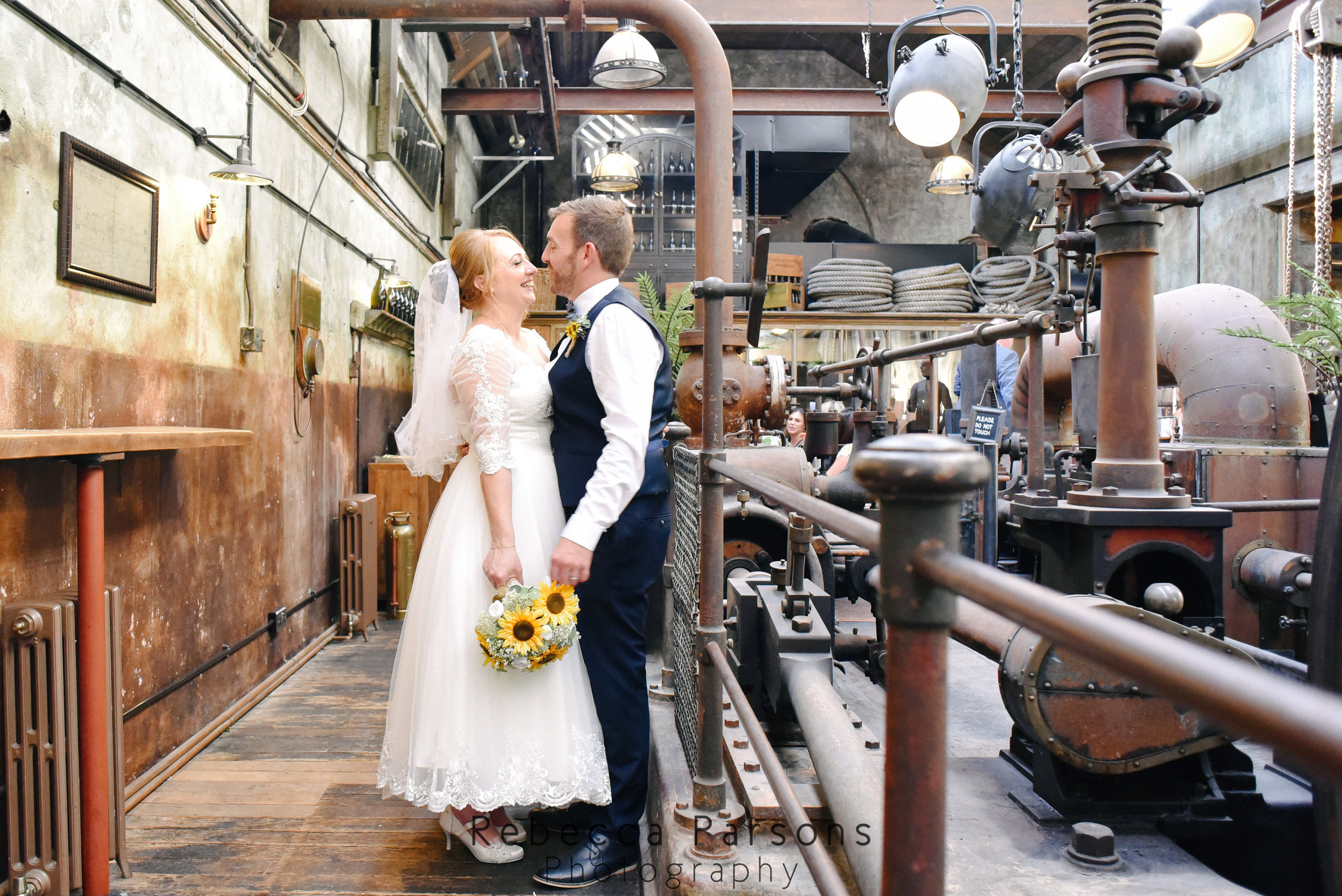 bride and groom in engine room