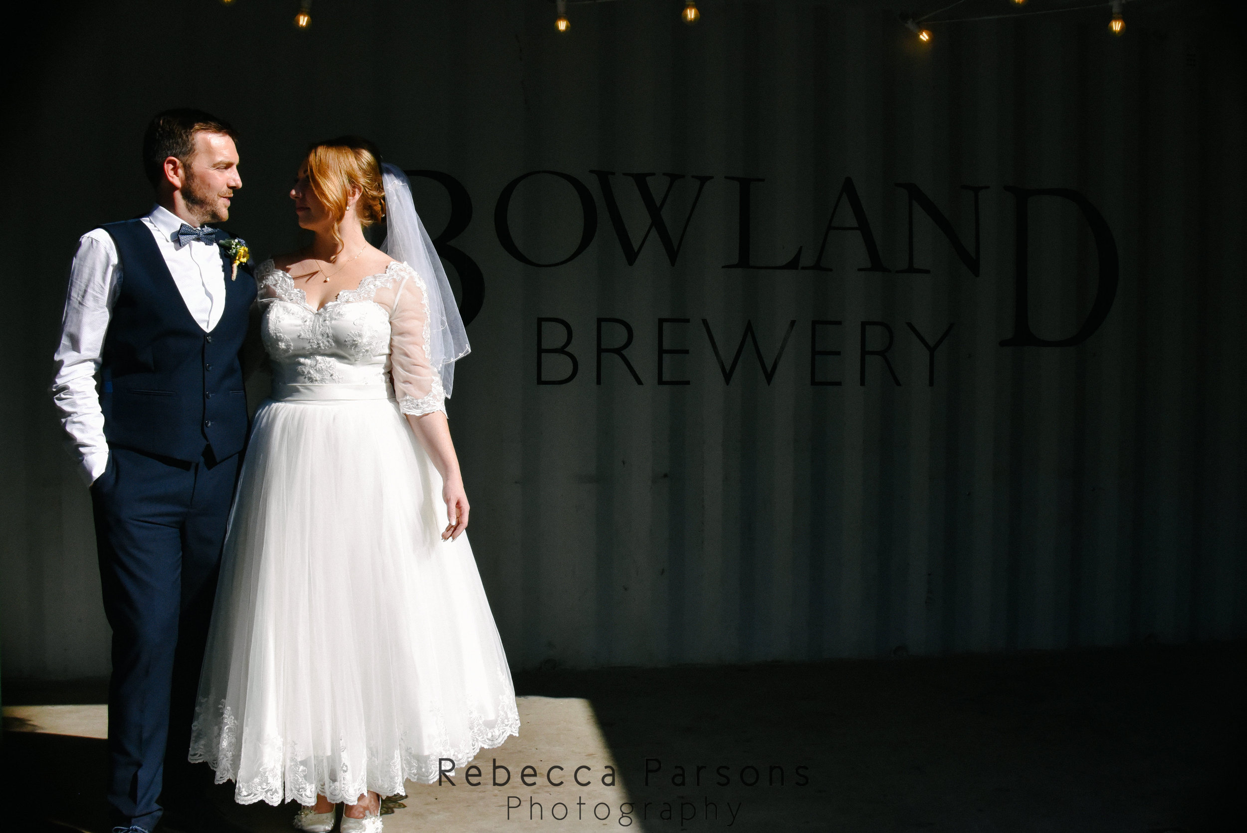 bride and groom in shadows