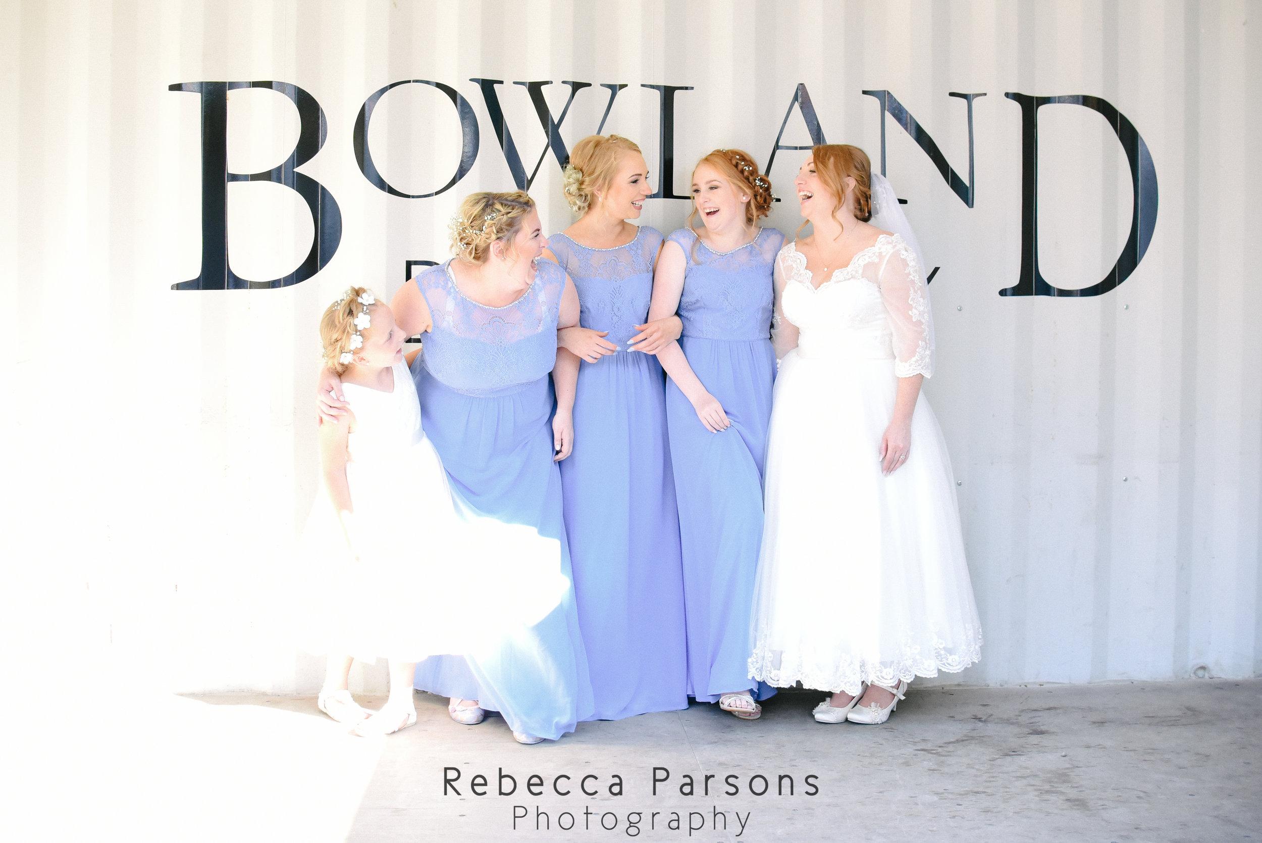 bridesmaids laughing in sunshine