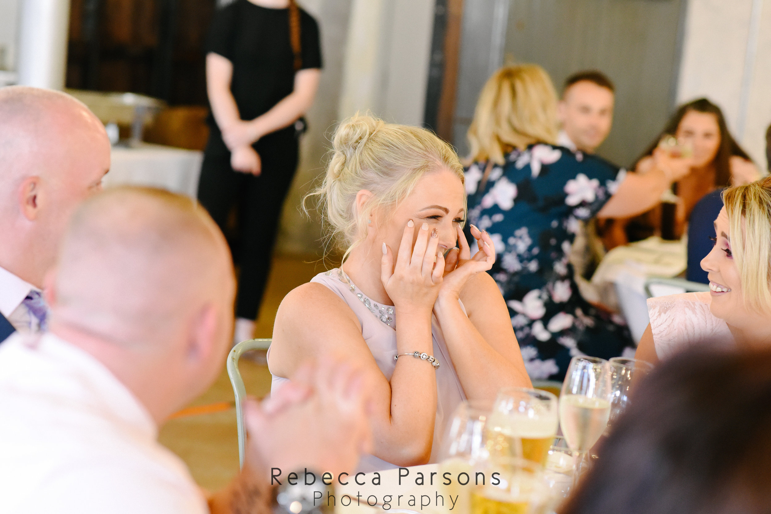 guest laughing wiping eyes