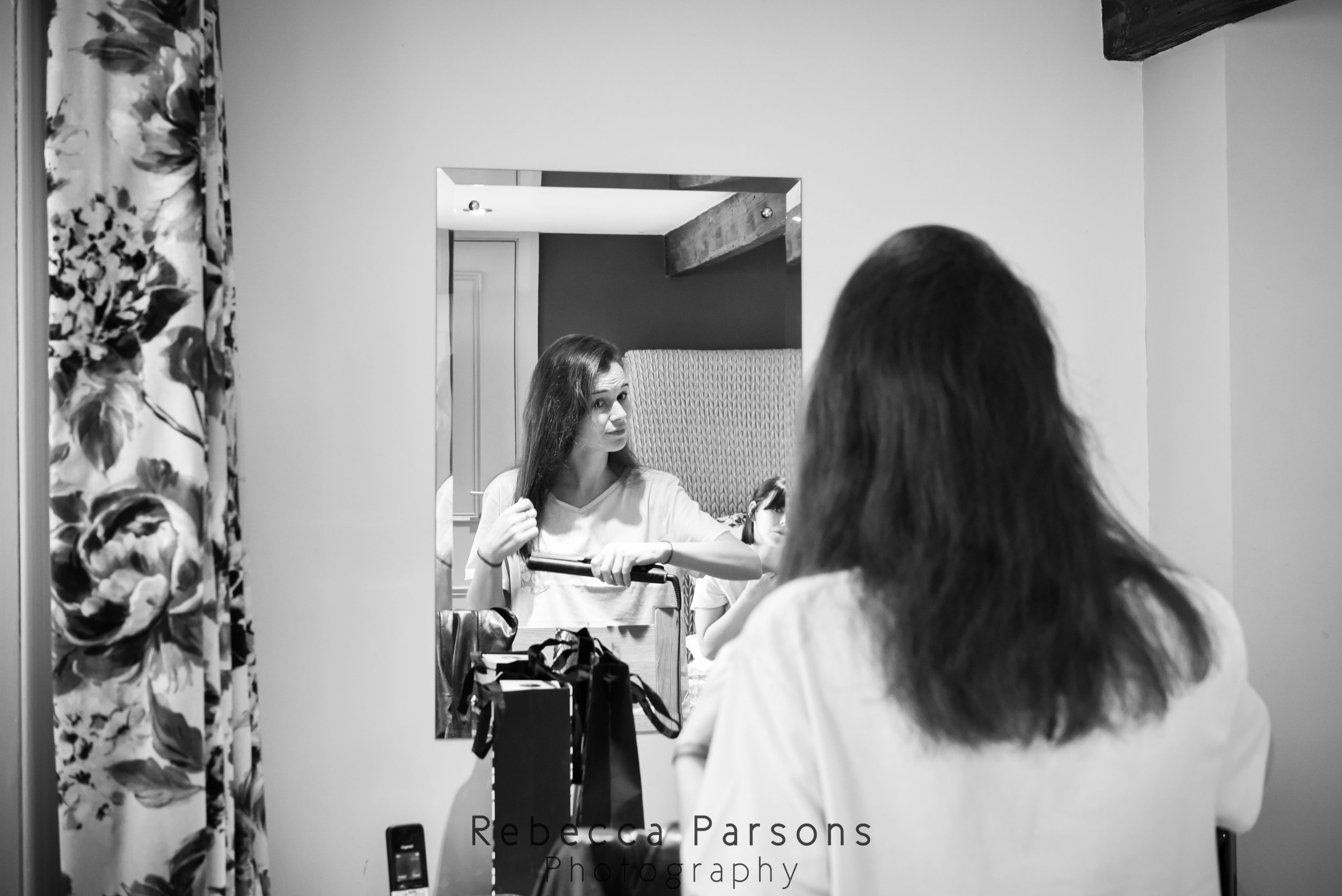 bridesmaid looking in mirror black and white
