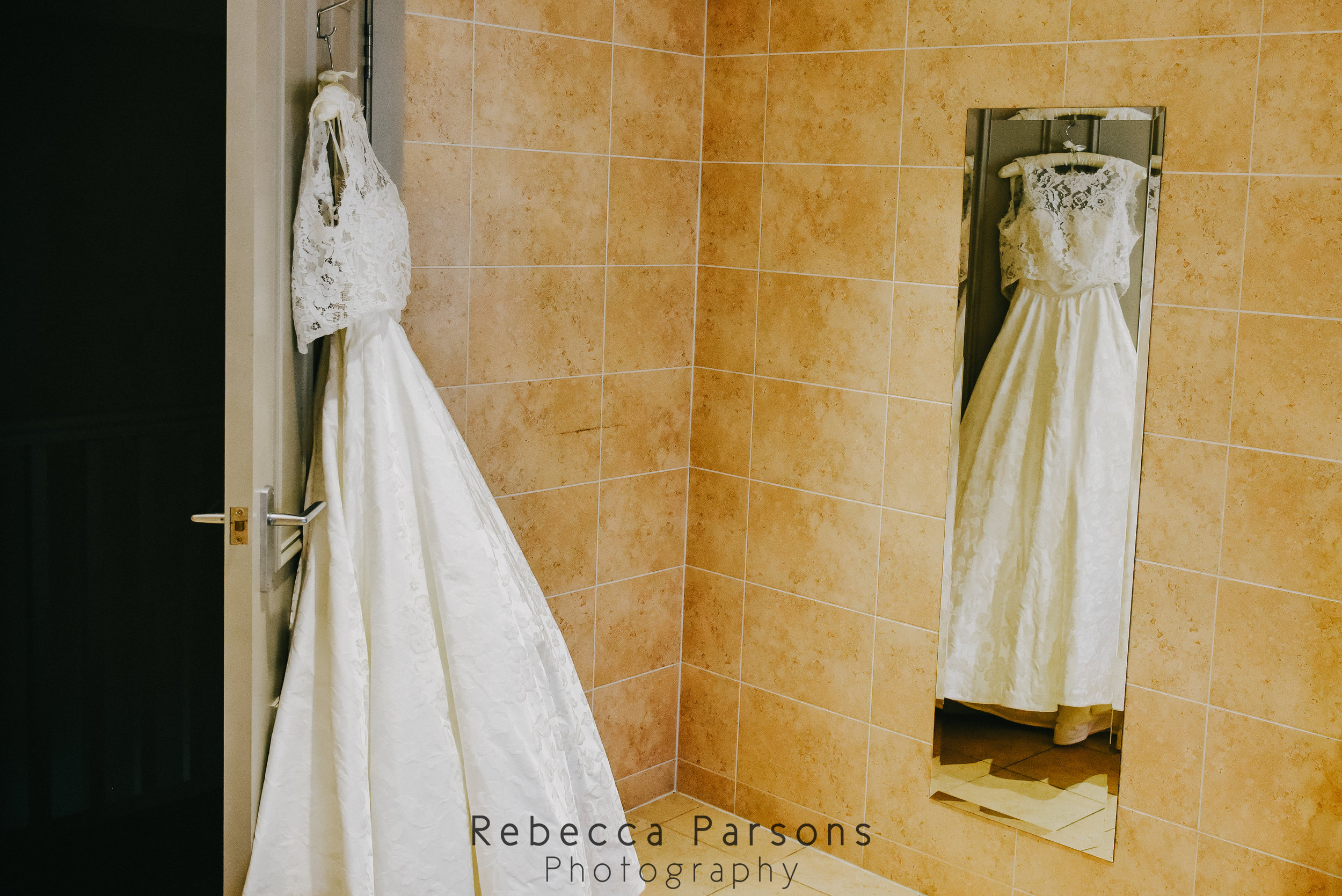 wedding dress reflected in mirror