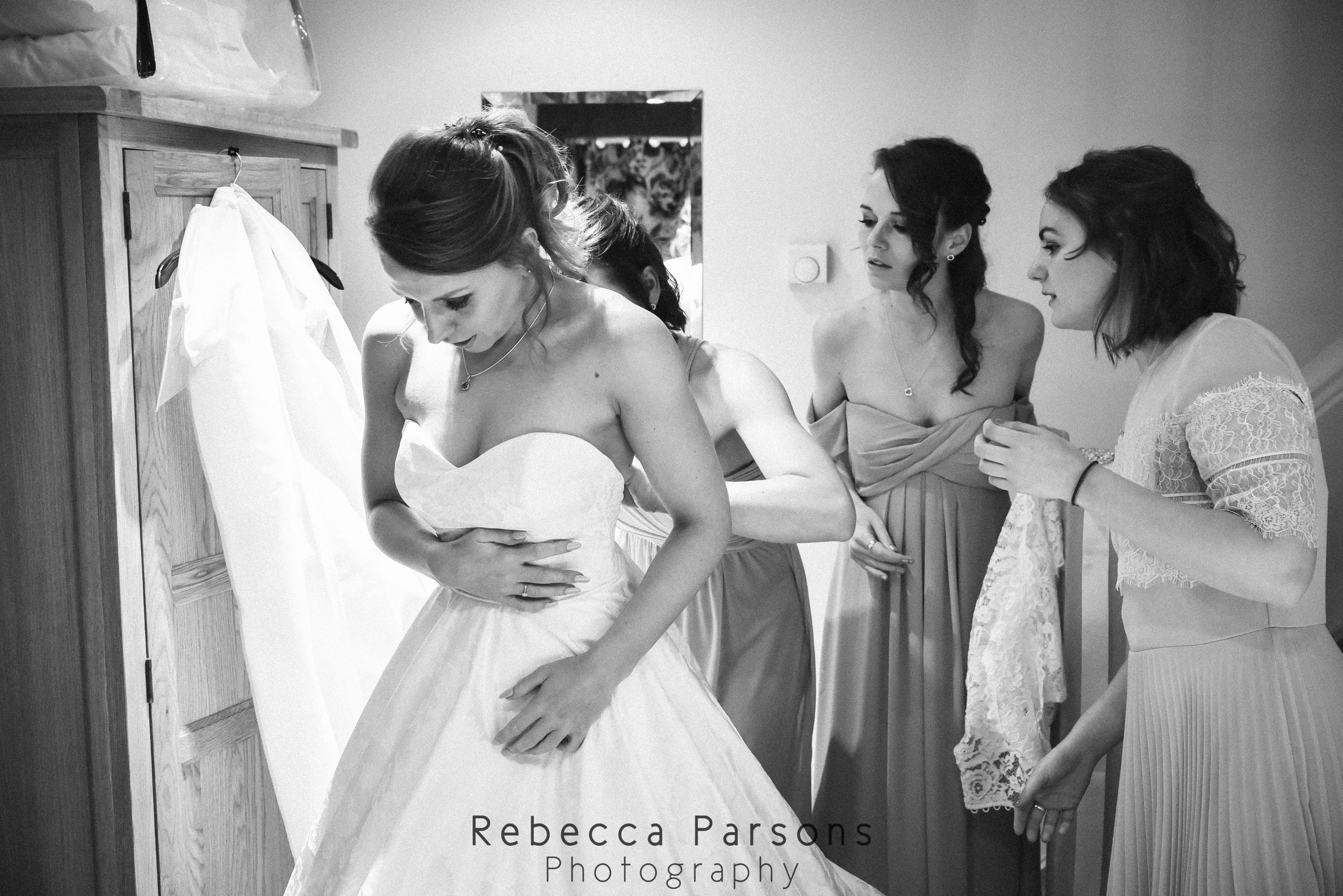 bride in dress with bridesmaids