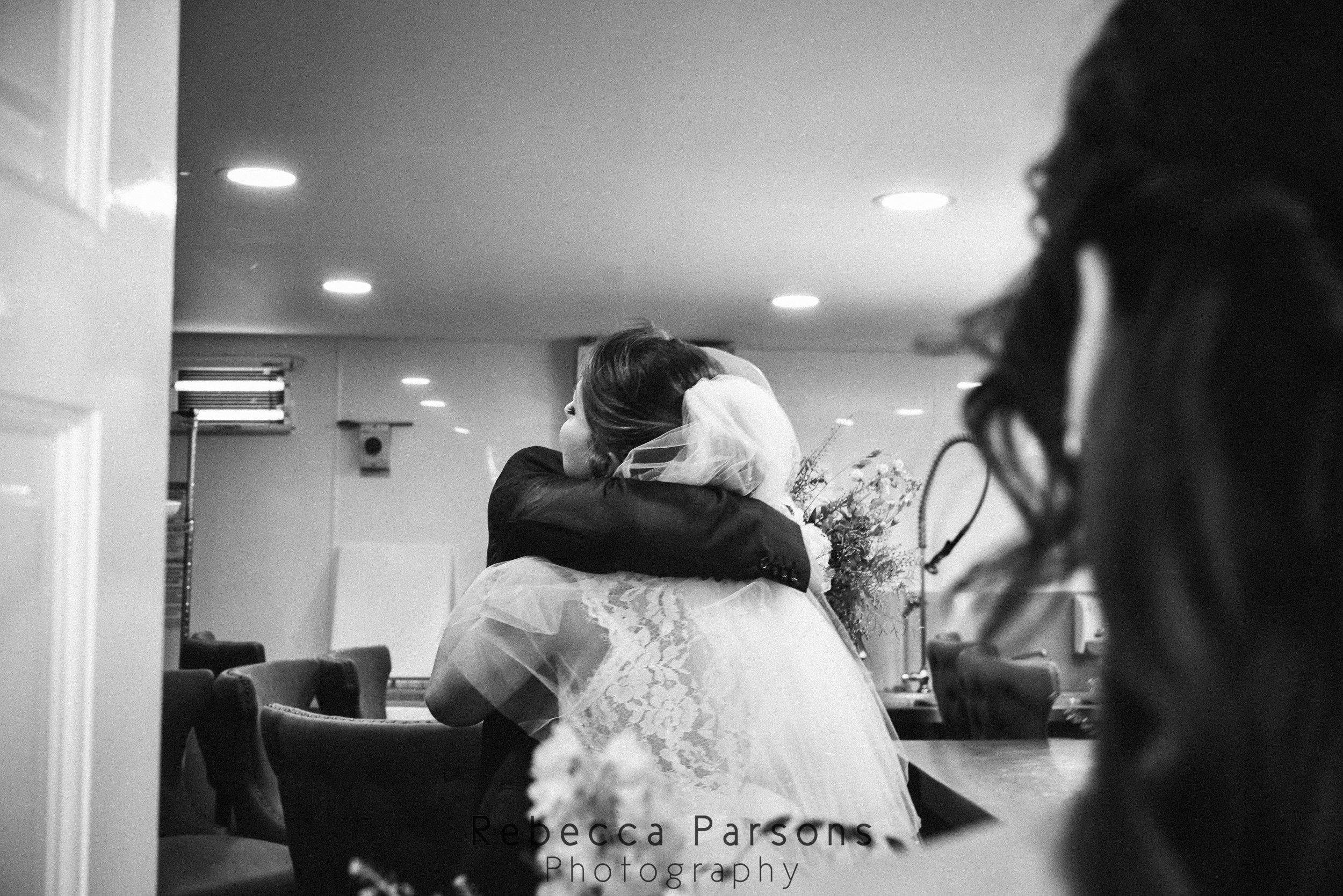 bride hugging dad black and white