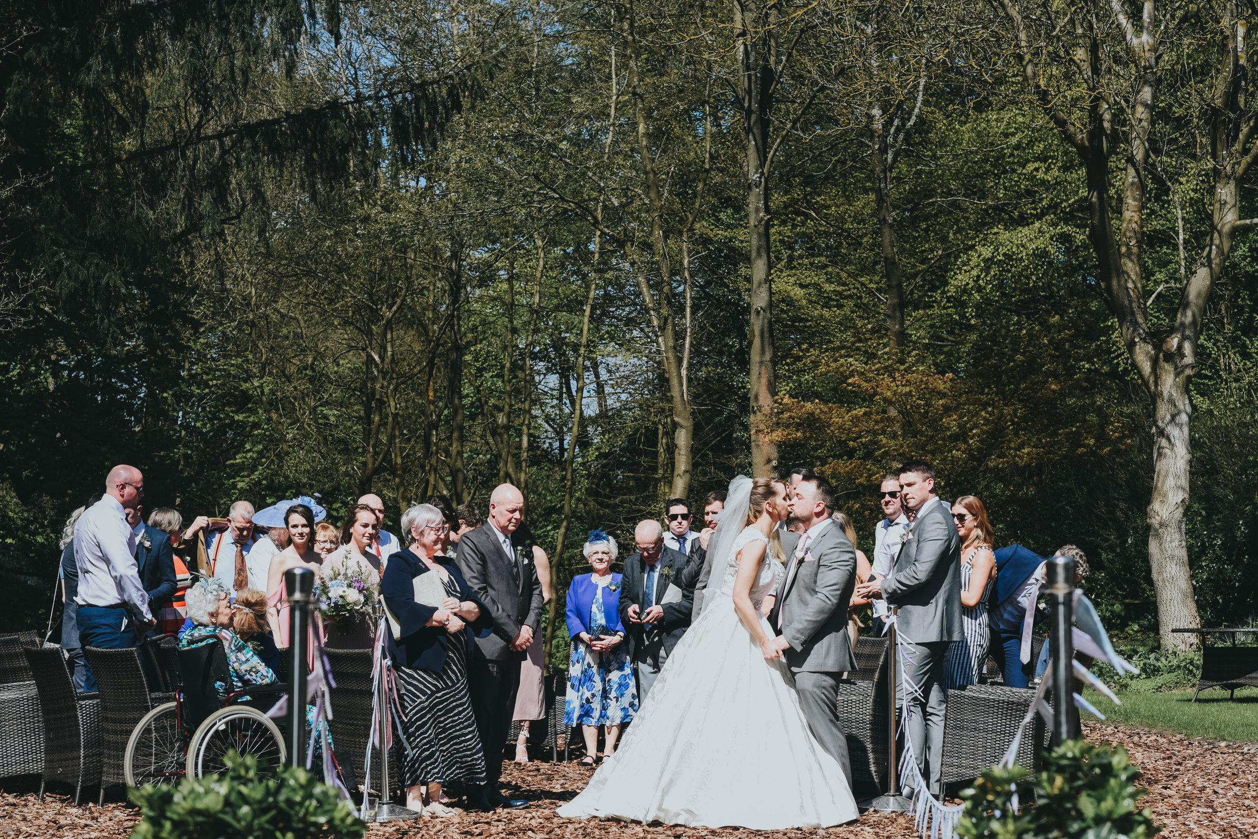 full wedding party watching wedding service