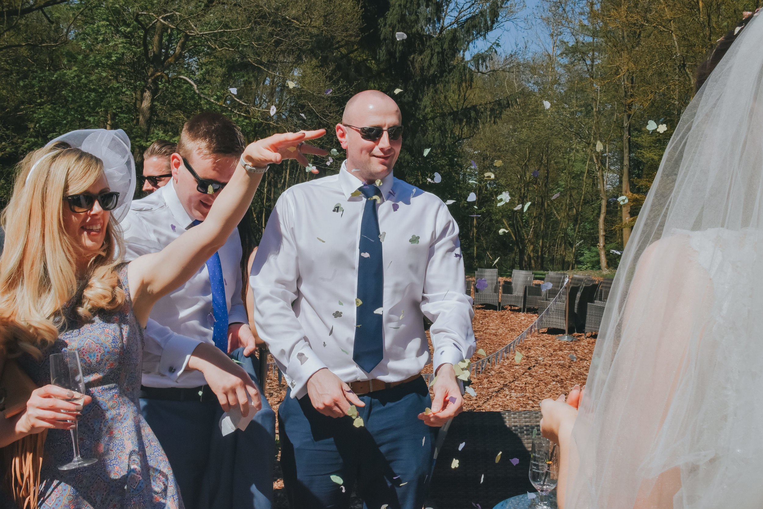 guests throwing confetti over bride