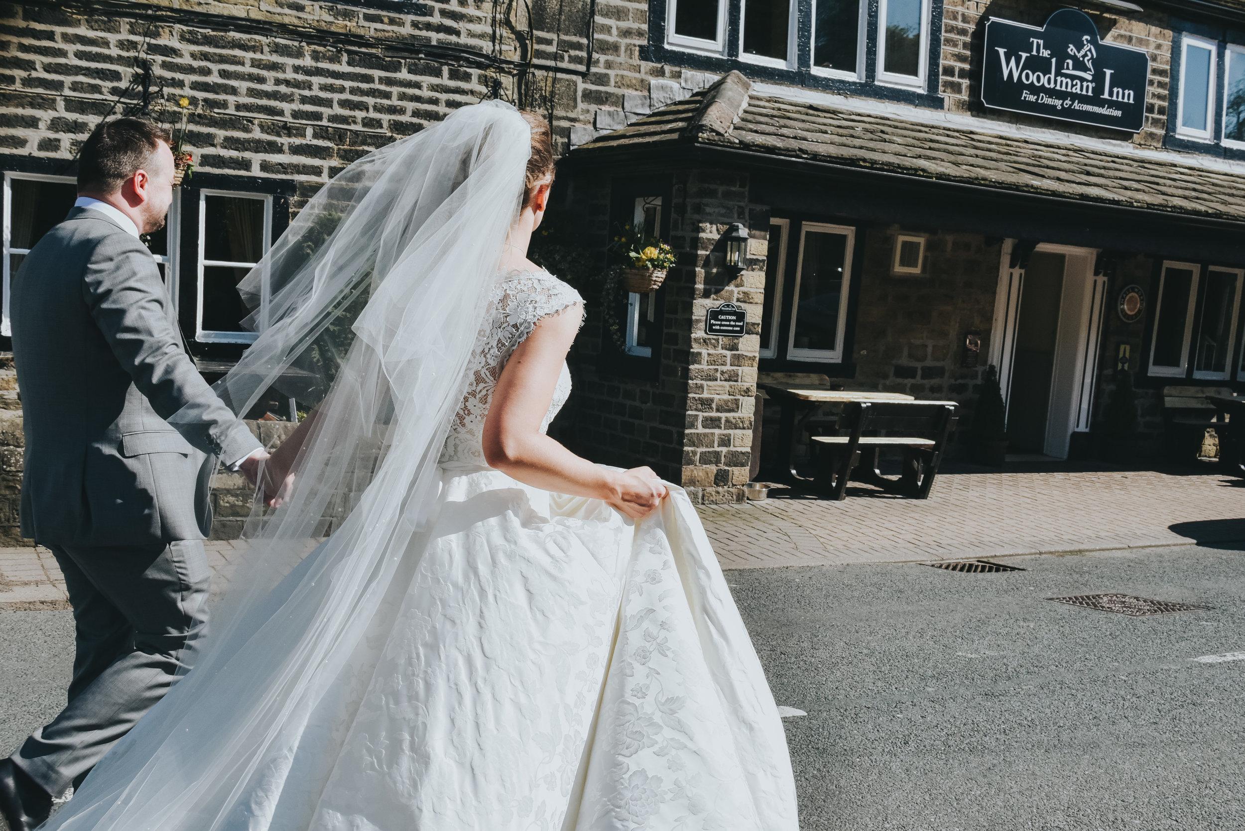 bride and groom outside Woodman Inn