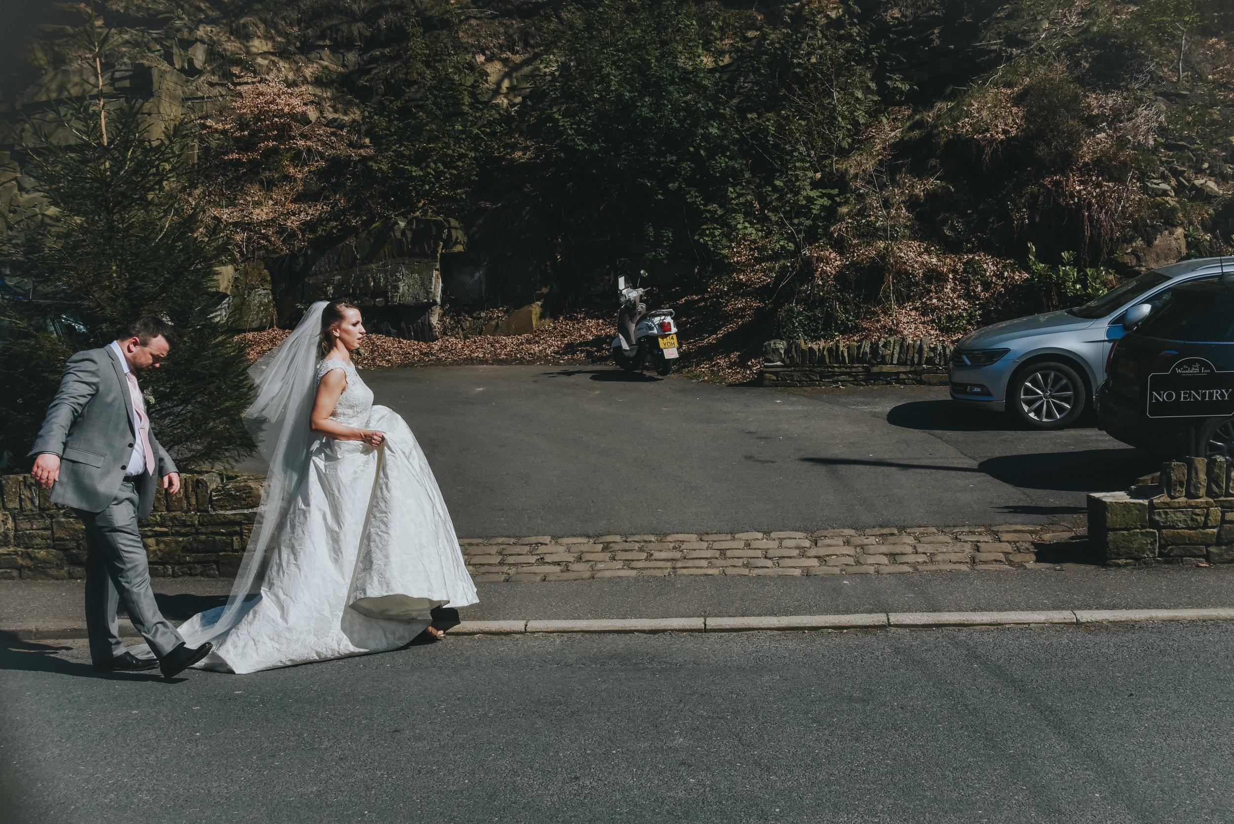 bride and groom walking down street