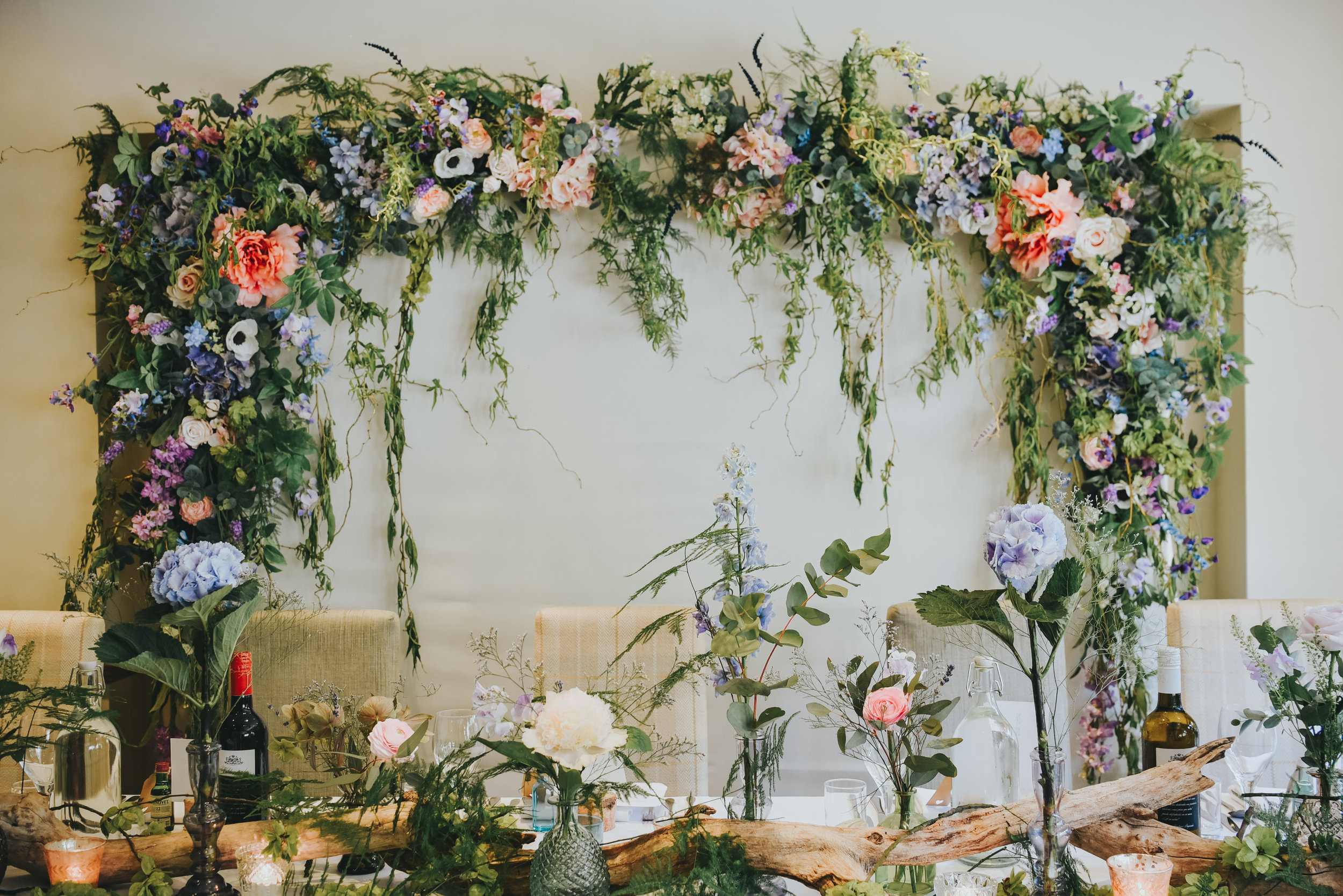 flower arch behind table