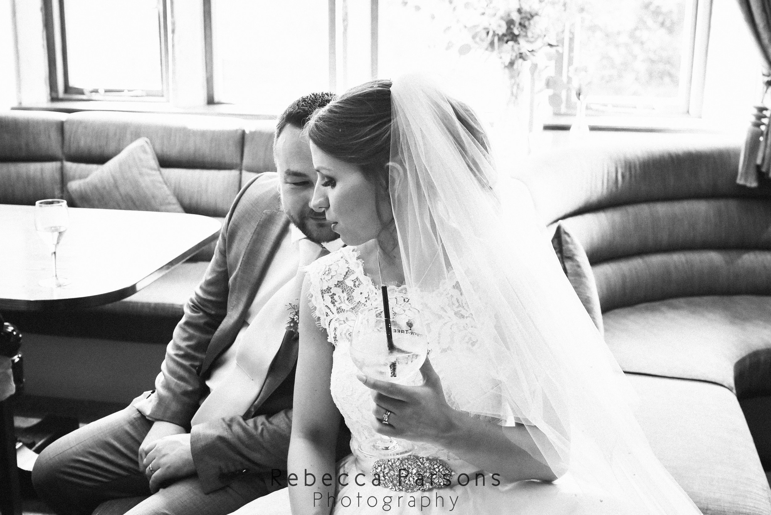 bride and groom sitting black and white