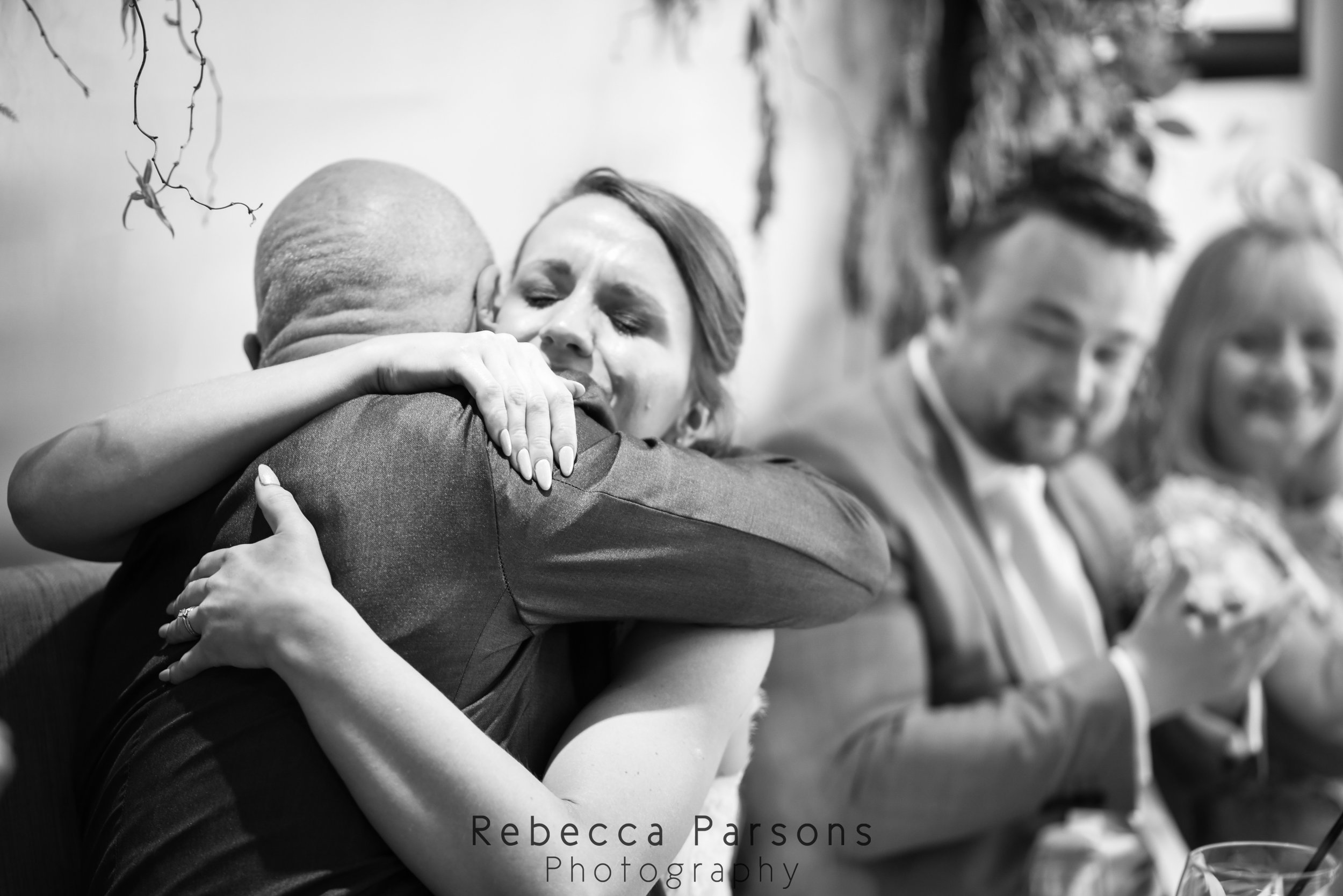 bride hugging dad black and white
