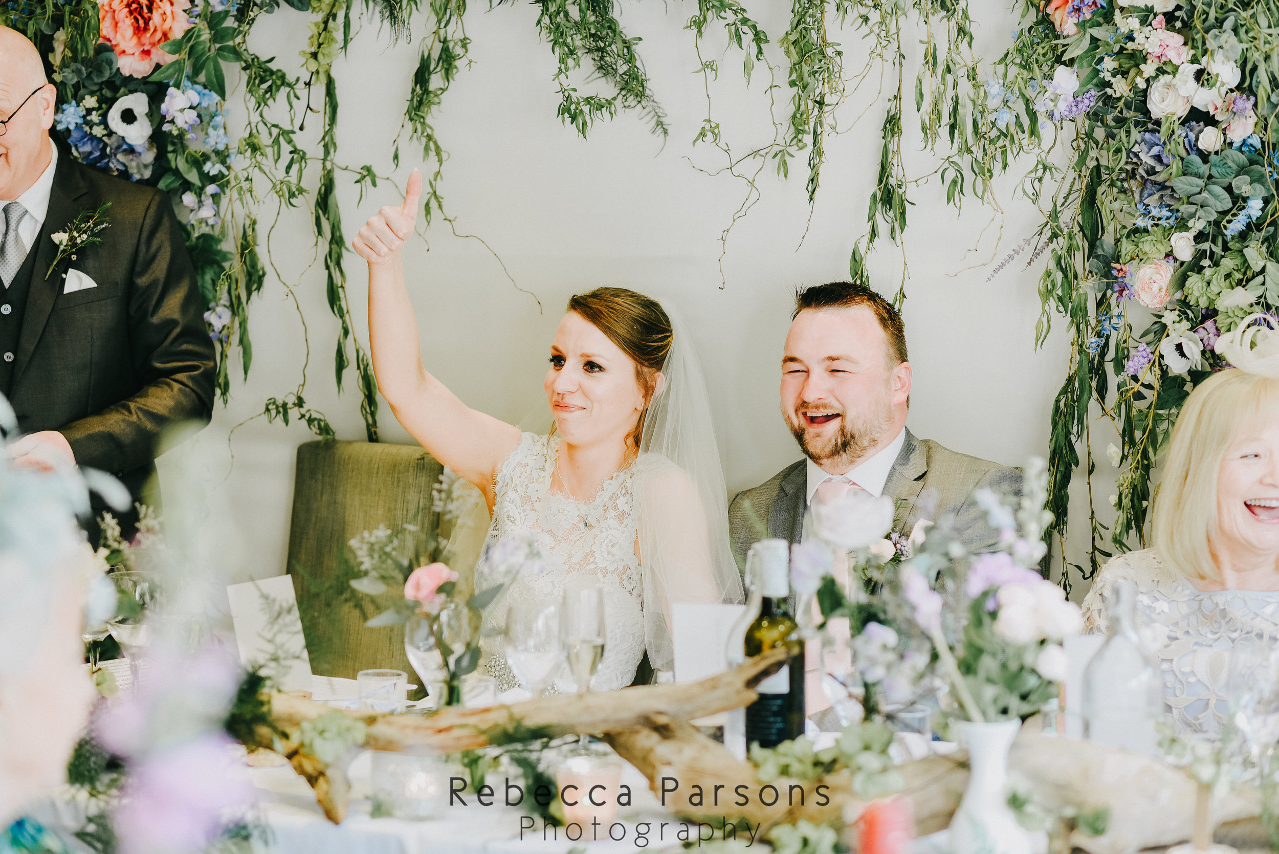 bride and groom raising glasses