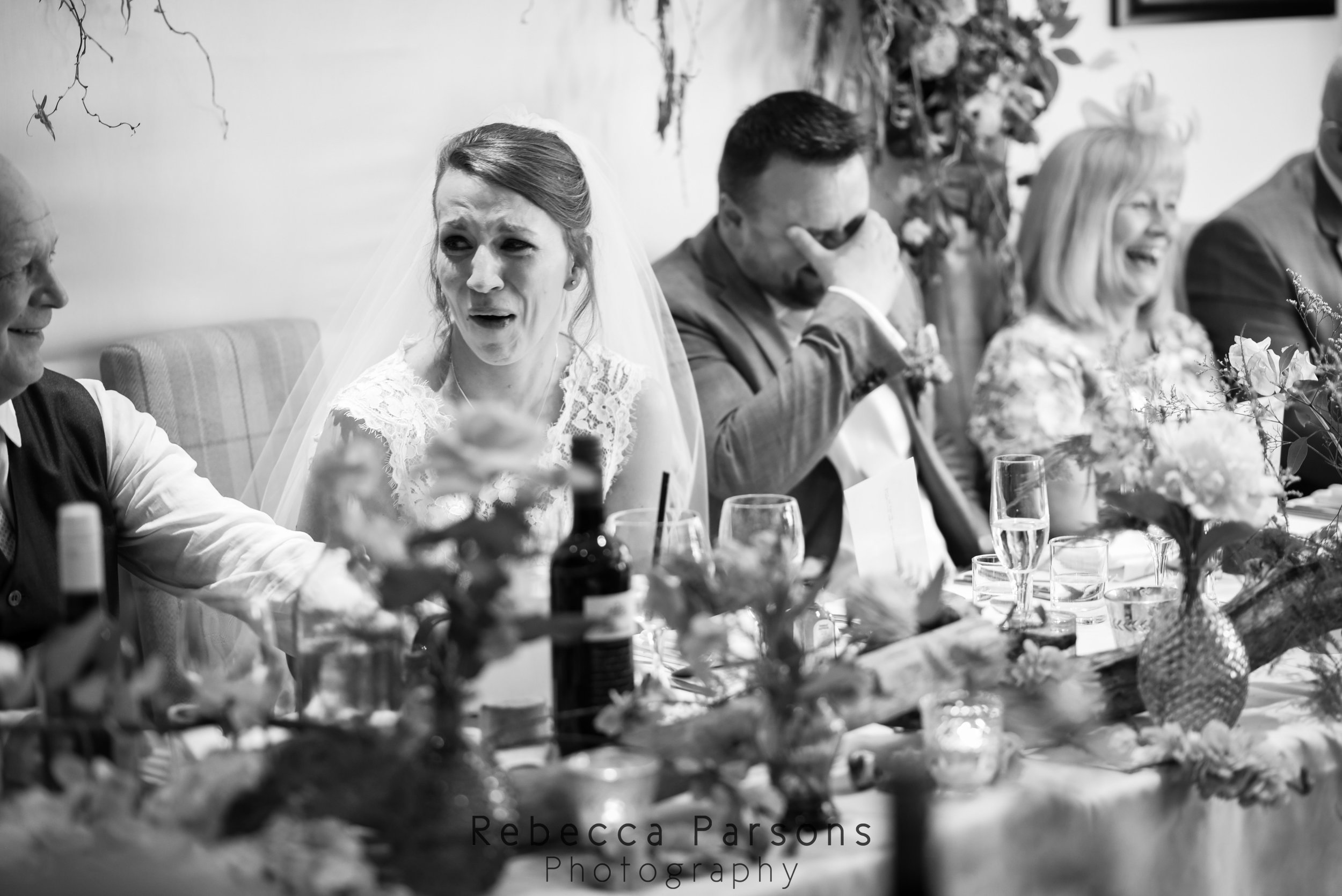 bride and groom during speeches black and white