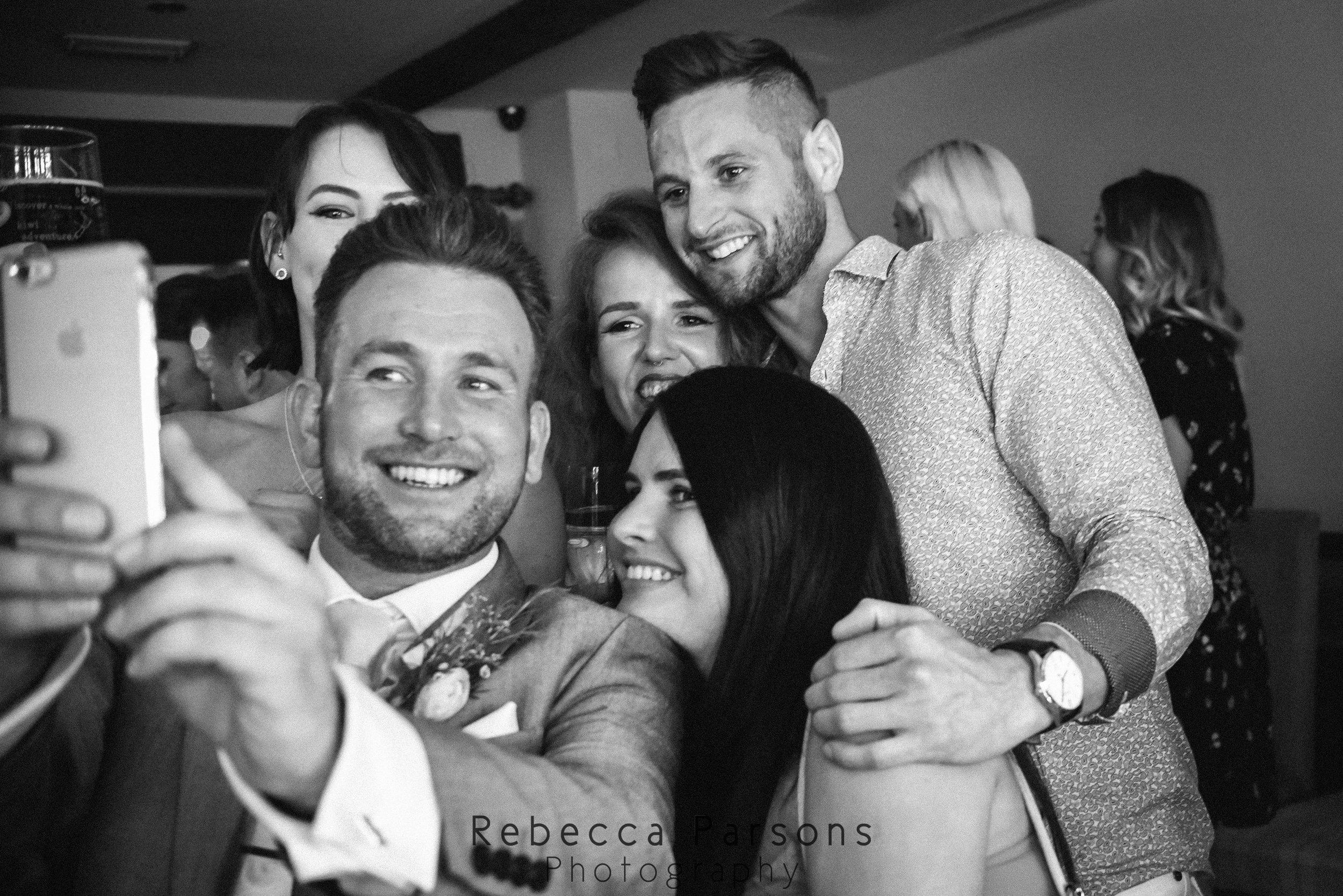 guests taking selfie black and white