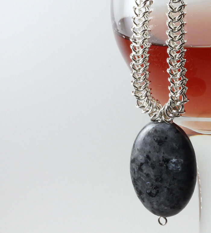 Sterling Silver Byzantine Chain with a Large Agate , presented by a glass of small-batch raspberry mead.