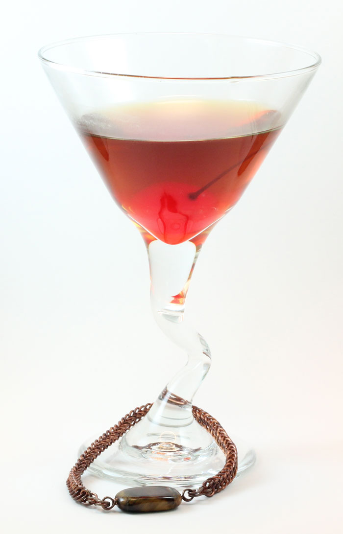 Copper Persian Bracelet with Tigerseye Bead.  Shown with a large Manhattan.