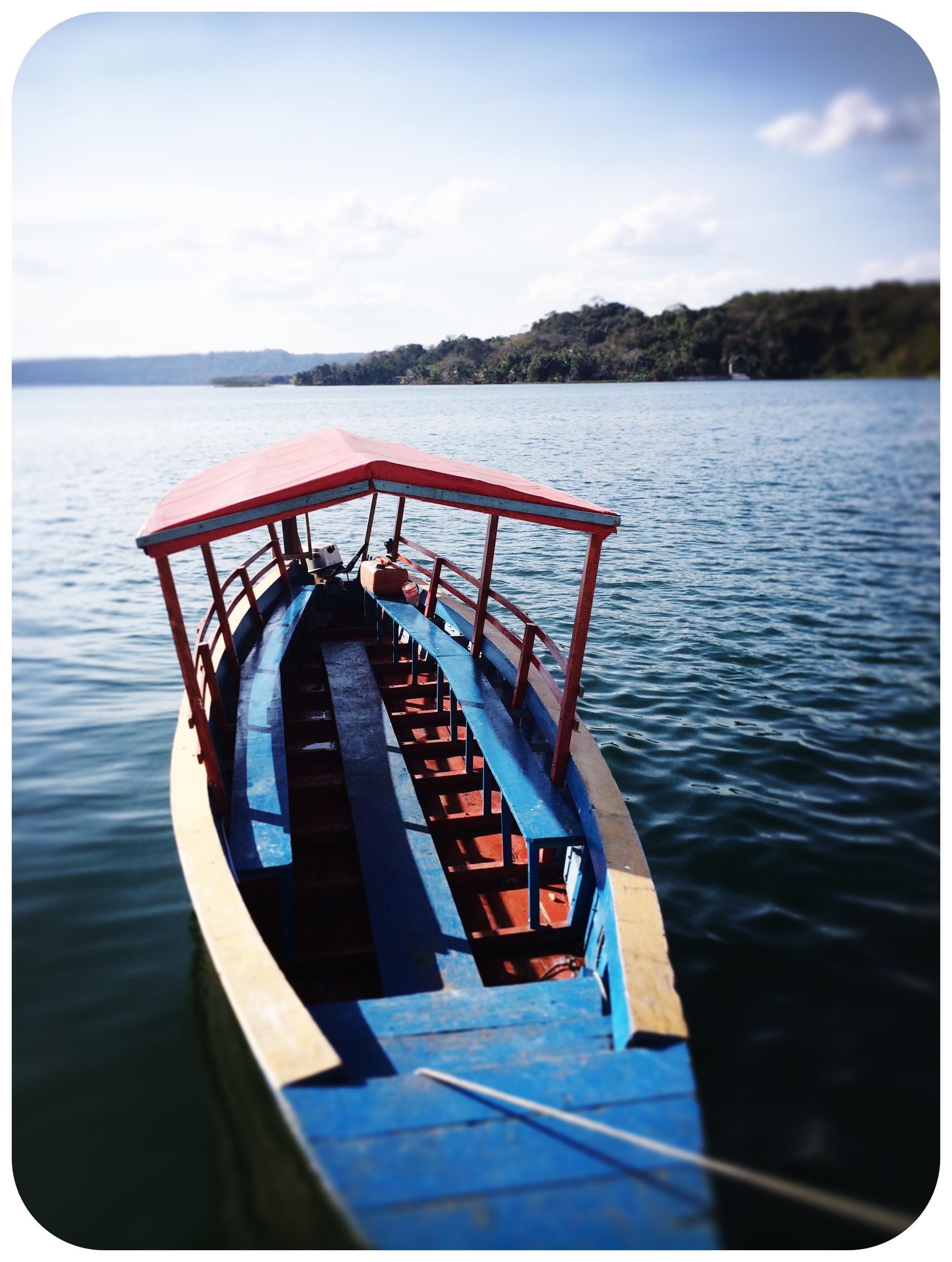 A launch awaits passengers on Guatemala's Lake Petén Itzá.   Photo by Michael Mundt