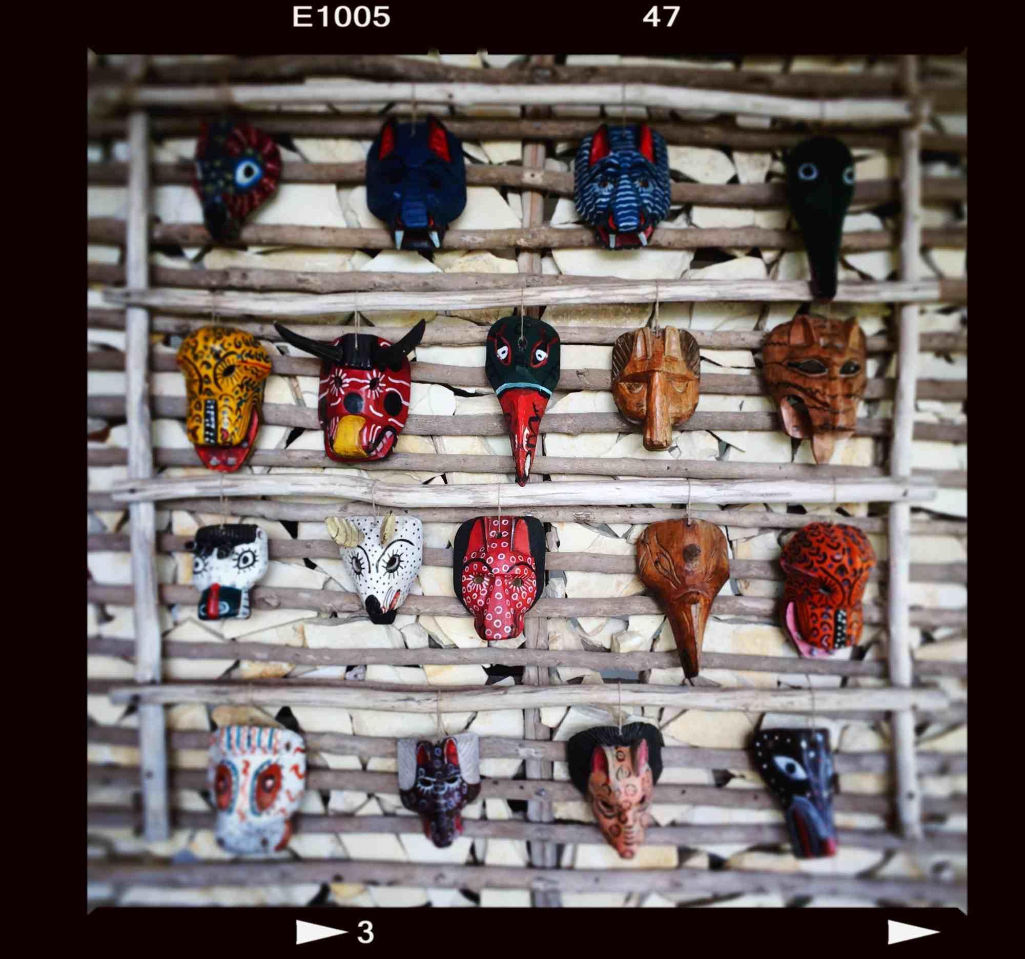 Colorful masks greet visitors at Coppola's La Lancha Resort near Flores, Guatemala.  Photos by Michael Mundt