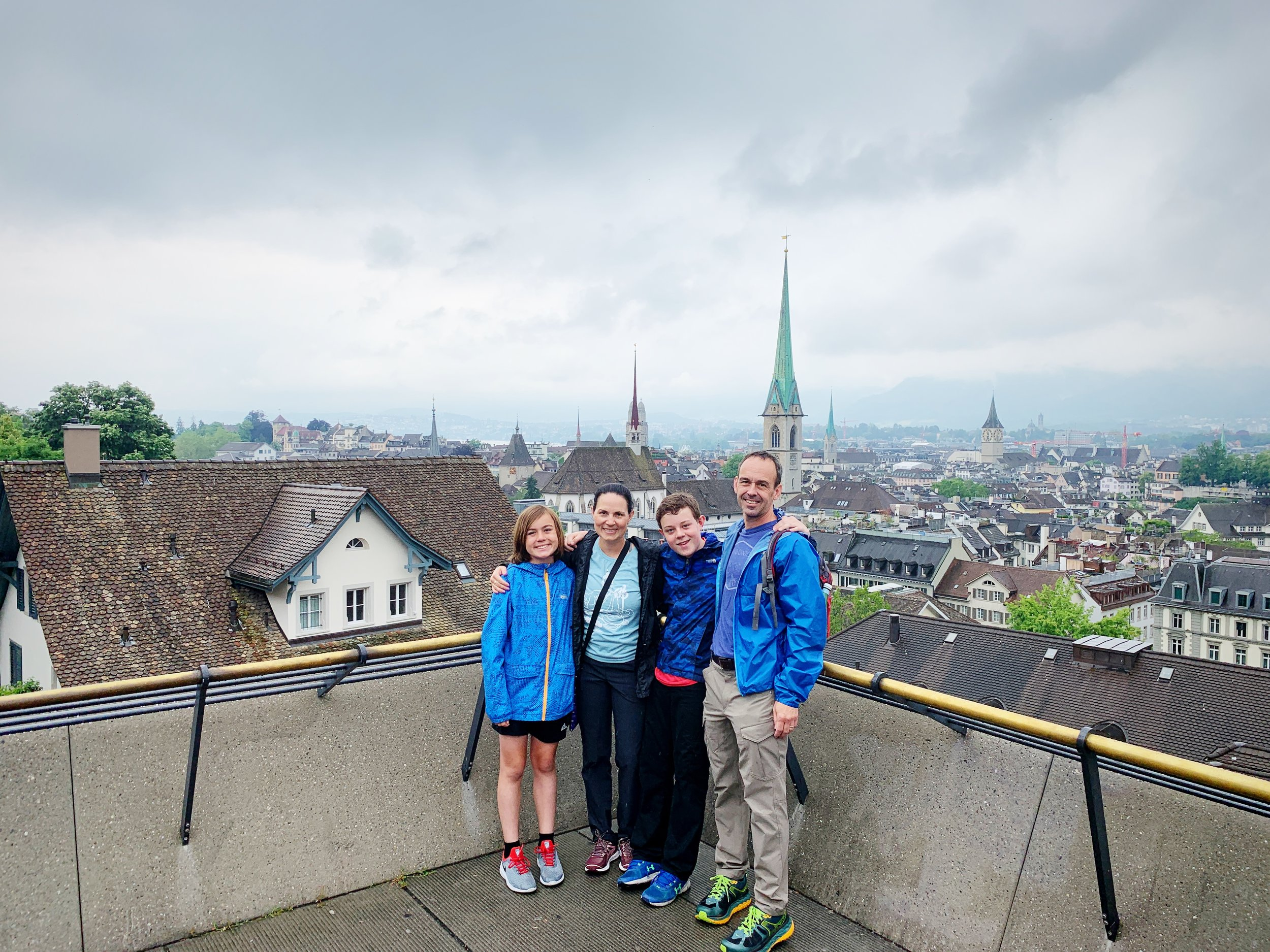 My family at the starting point of our complicated Summer 2019 itinerary, Zurich, Switzerland, which we planned with the help of Tamara McDonald, a travel manager at Vacationkids.com.