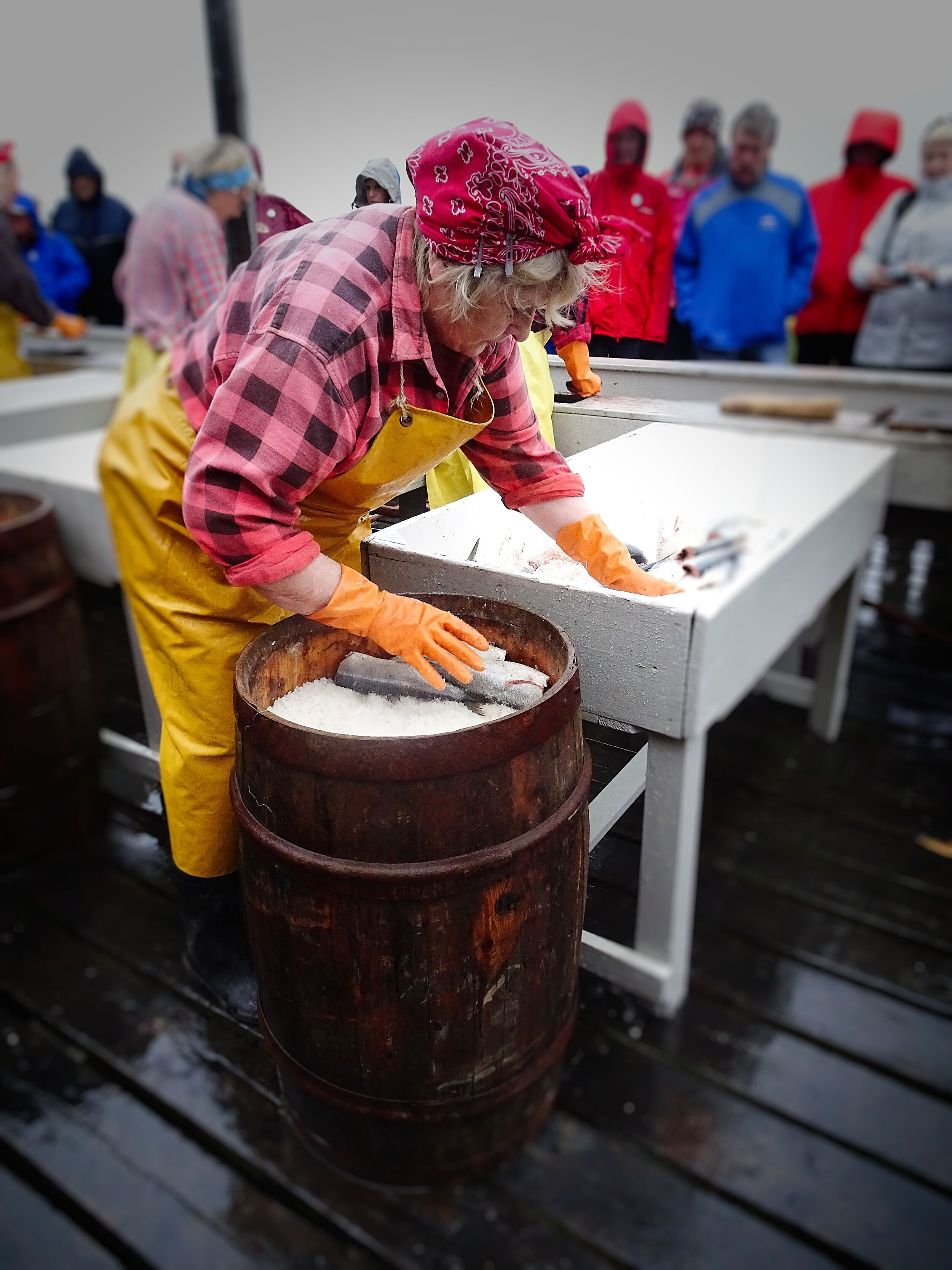 """A re-enactment of the """"herring girls"""" packing barrels of fish.  Photo by Michael Mundt."""