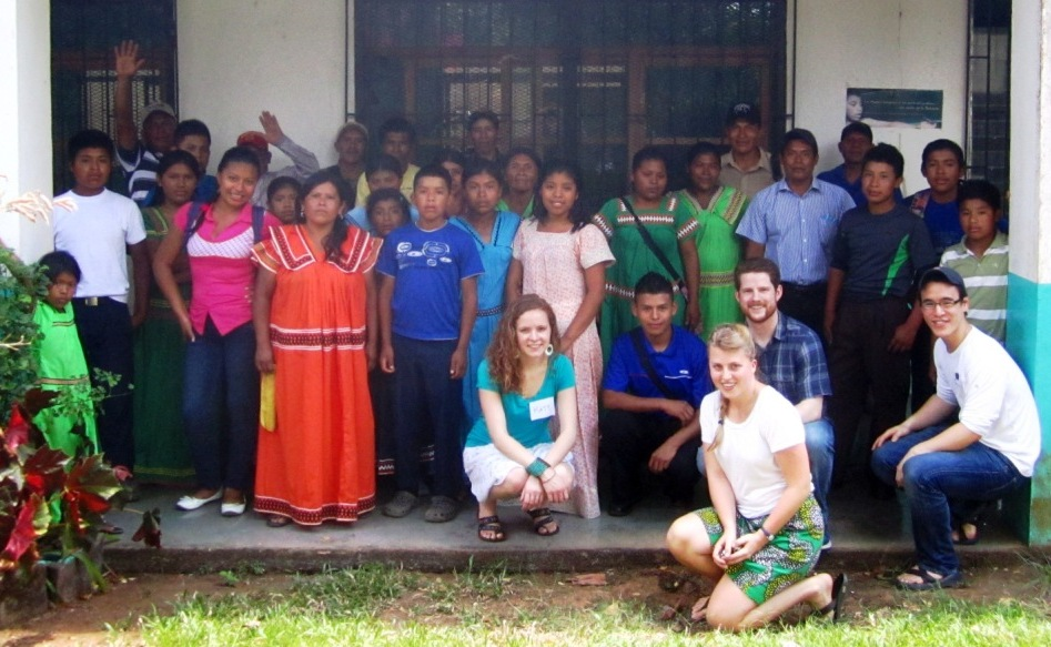 Few for Change volunteers celebrate with students, family members and volunteers in Quebrada Guabo, Panama.