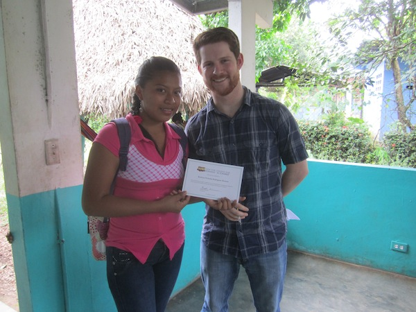Brooks presenting Karmen with her certificate.