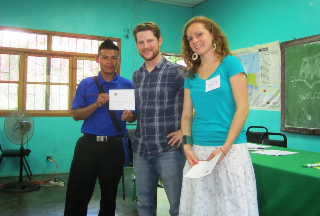 Few for Change Co-Director Brooks Winner (center) and volunteer Katie Clay (right) present Few for Change scholar Aquilino Andrades Santo with a certificate.