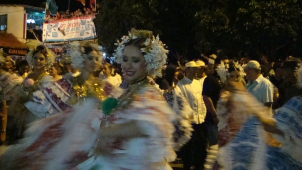 Women dancing and wearing  polleras  - the national costume of Panama.