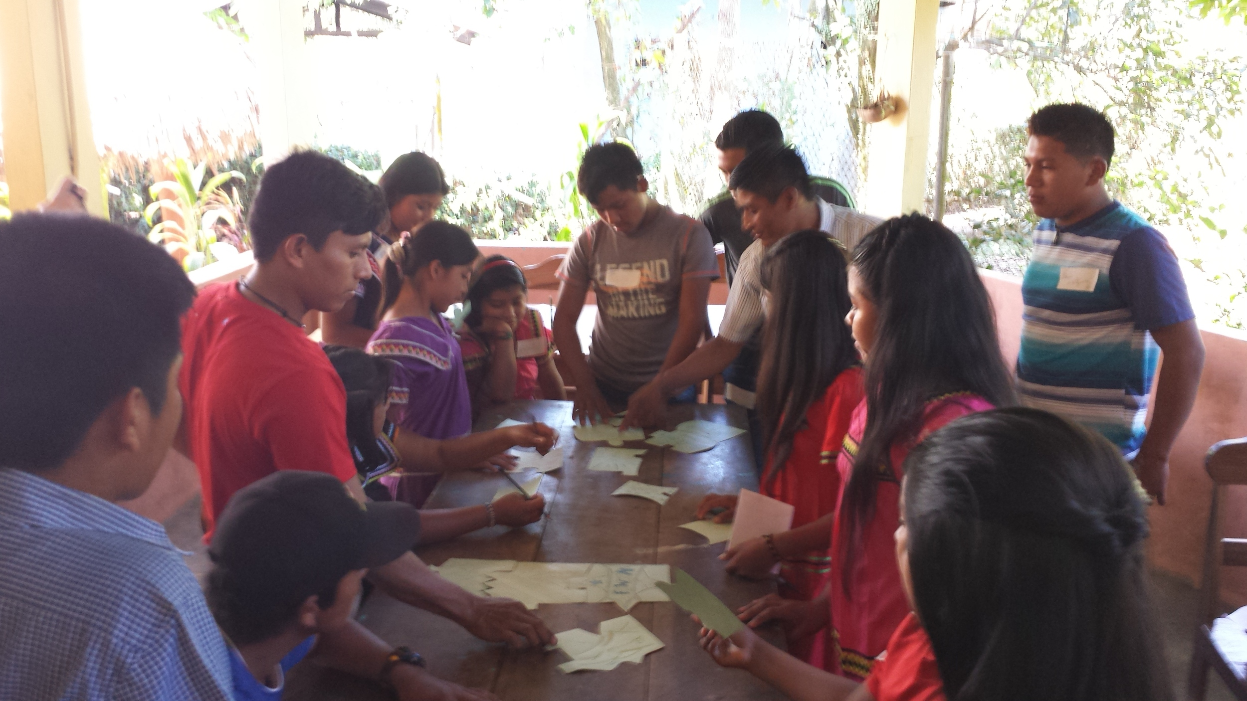 9.   Students completing a puzzle with each of their names on one piece. Our students come from multiple communities and attend many different schools; some have known each other for years, and some have never met or only see each other once a year at the entrega.  It's always great to see our students working together and getting to know each other during the entrega ceremony.
