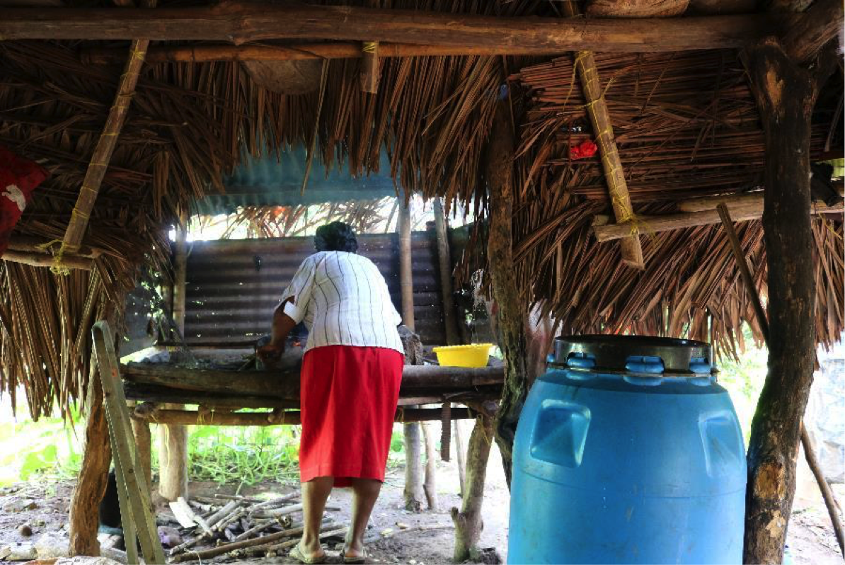 Doris cooks a meal from her traditional outdoor kitchen.