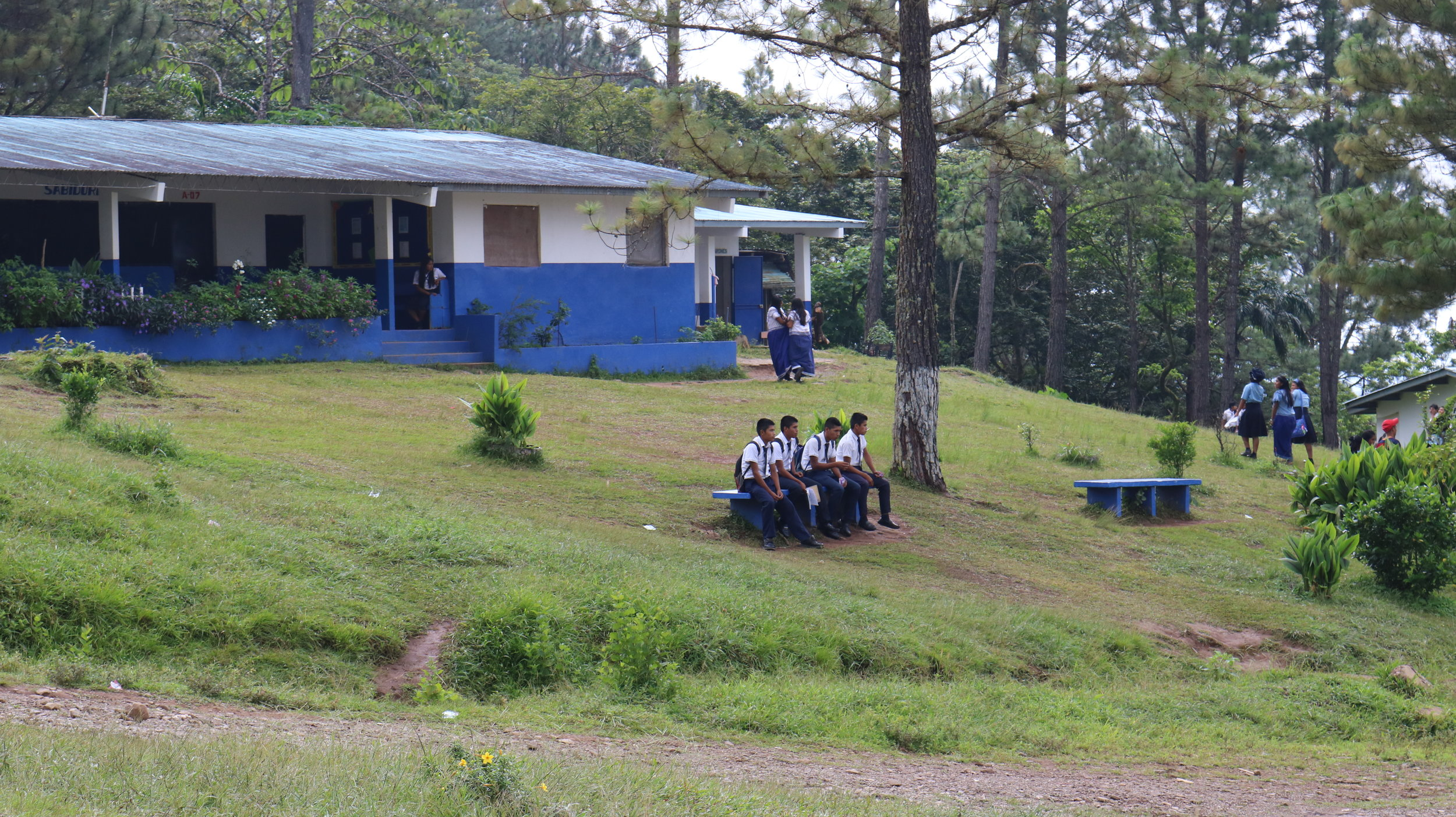 Students wait for school to start in Chami.