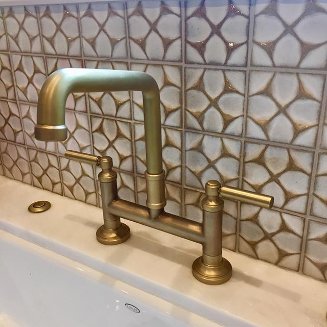 Beautiful dimensional tile from @annsacks_atx with brass bridge faucet from @kallistaplumbing in our recently completed Bryker Woods remodel.