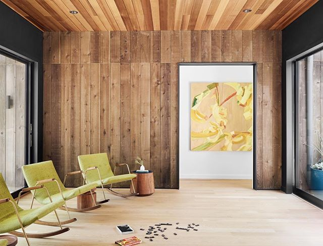 Amazing painting by our favorite artist @sydney.p.yeager near the lounge area of our #MananaLakeHouse project. Milo Baughman rockers offer a cozy spot to look at the lake. Photo by @caseycdunn with shoot styling assist from @katie_volk. Built by @aceroconstruction and architecture by @stuartsampley