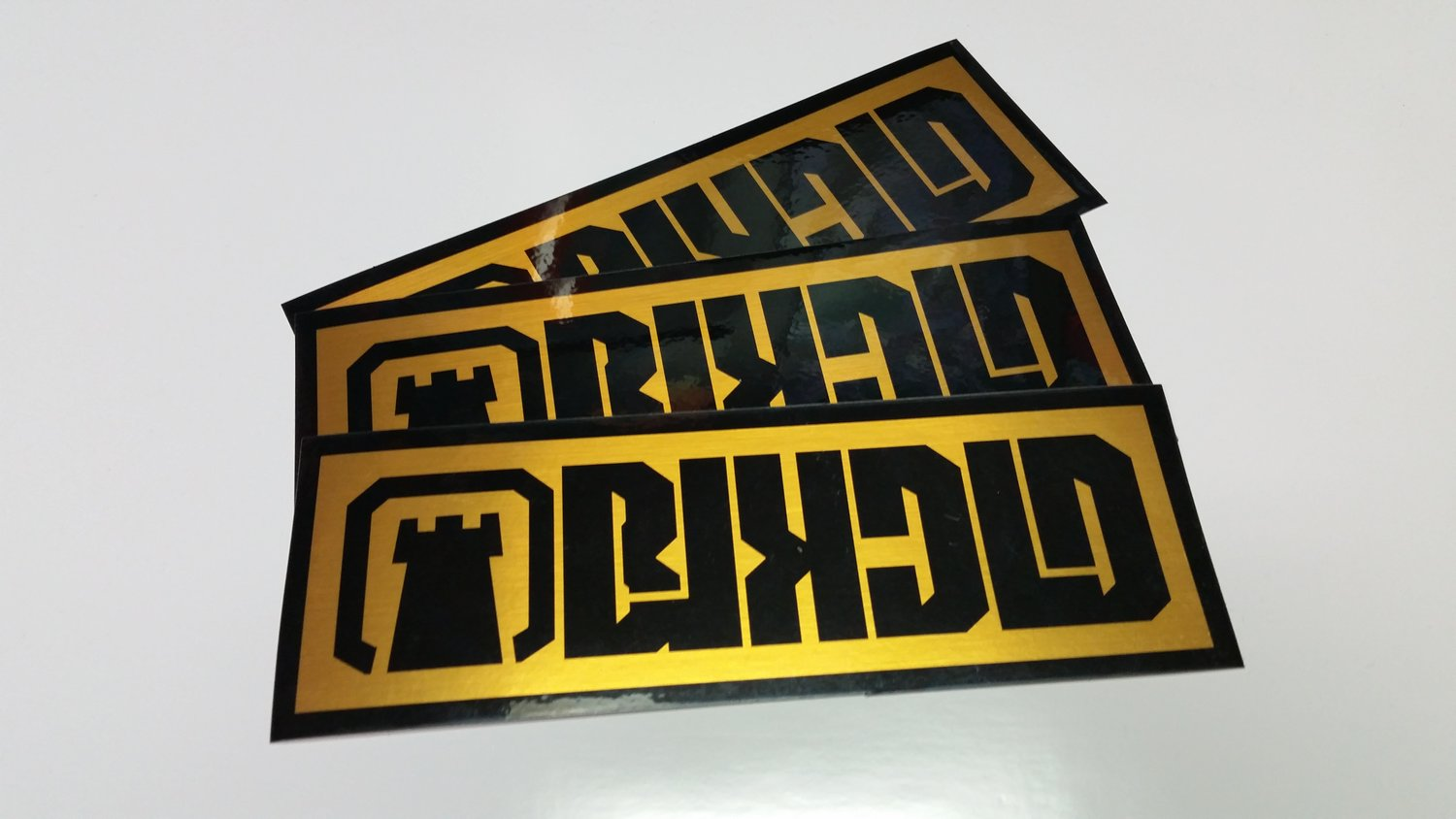 New black on brushed gold BLKCLD stickers are here. The pictures don't do them justice.