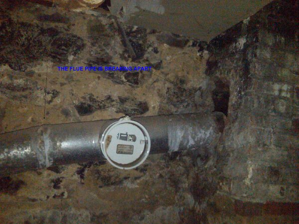 flue pipe is breaking apart.jpg
