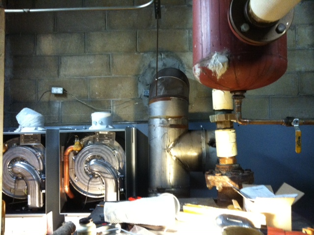 During installation: Working behind the existing boiler