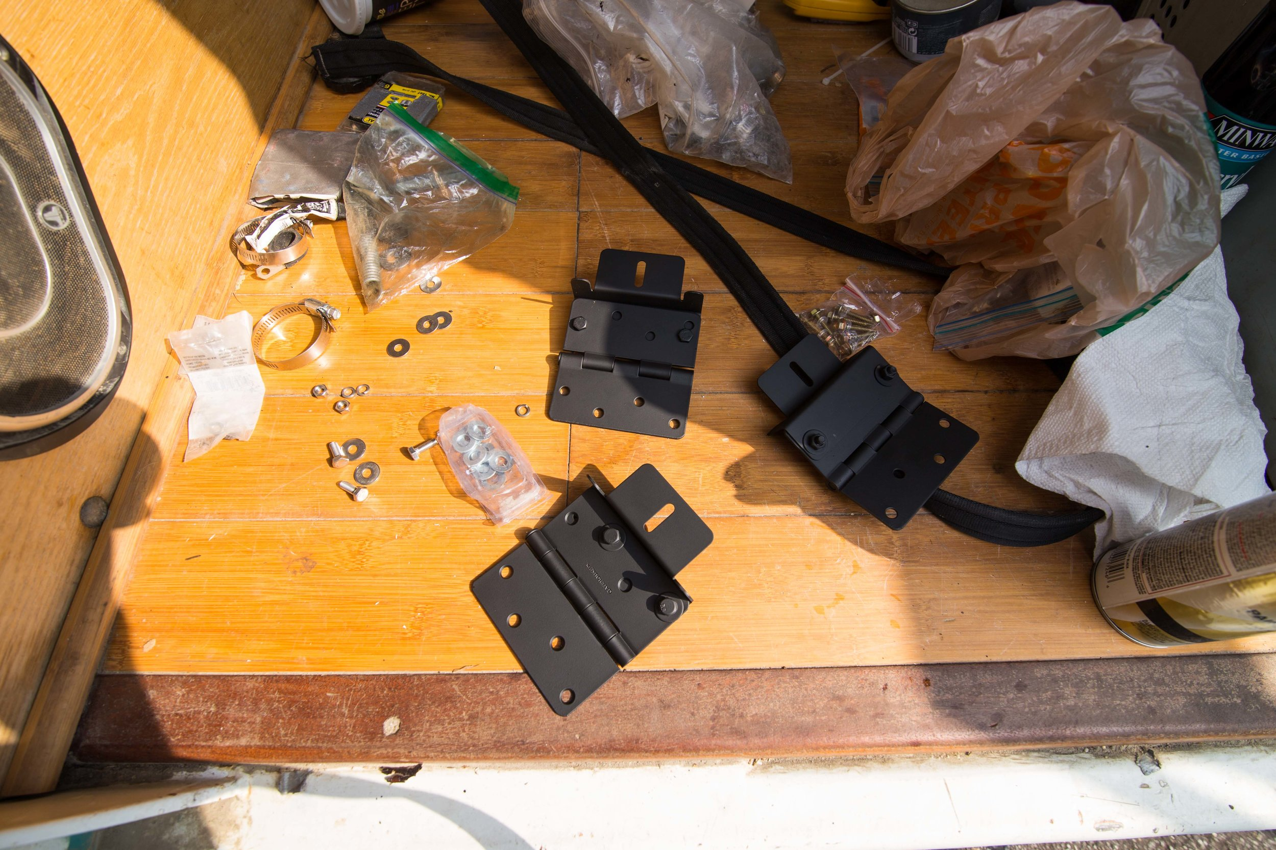 Once you have the holes drilled mount the hardware to join the two. I spray painted everything black for a cleaner look that matches the black edges of the solar panels. The mounting brackets come in a silver finish, and the hinges come in an assortment of finishes.
